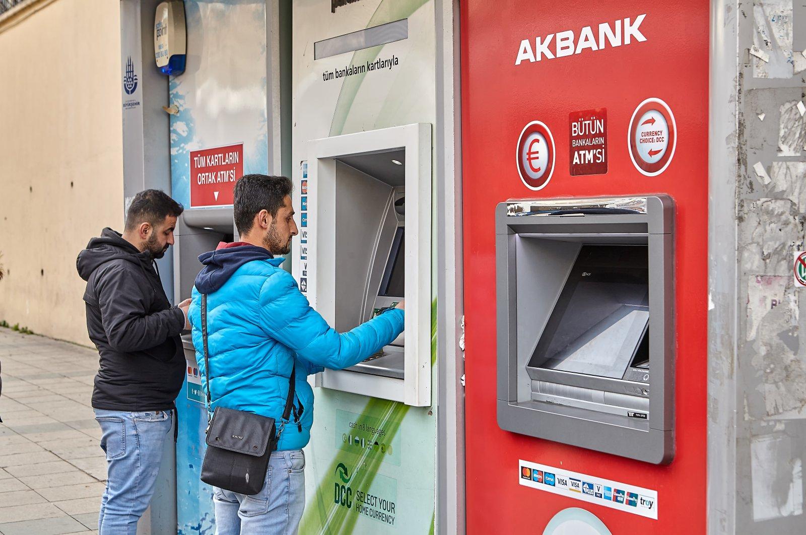 Three banks', namely, Denizbank, Akbank and Garanti bank, ATMs on a street in Istanbul, Turkey, Feb. 14, 2020. (Shutterstock Photo)