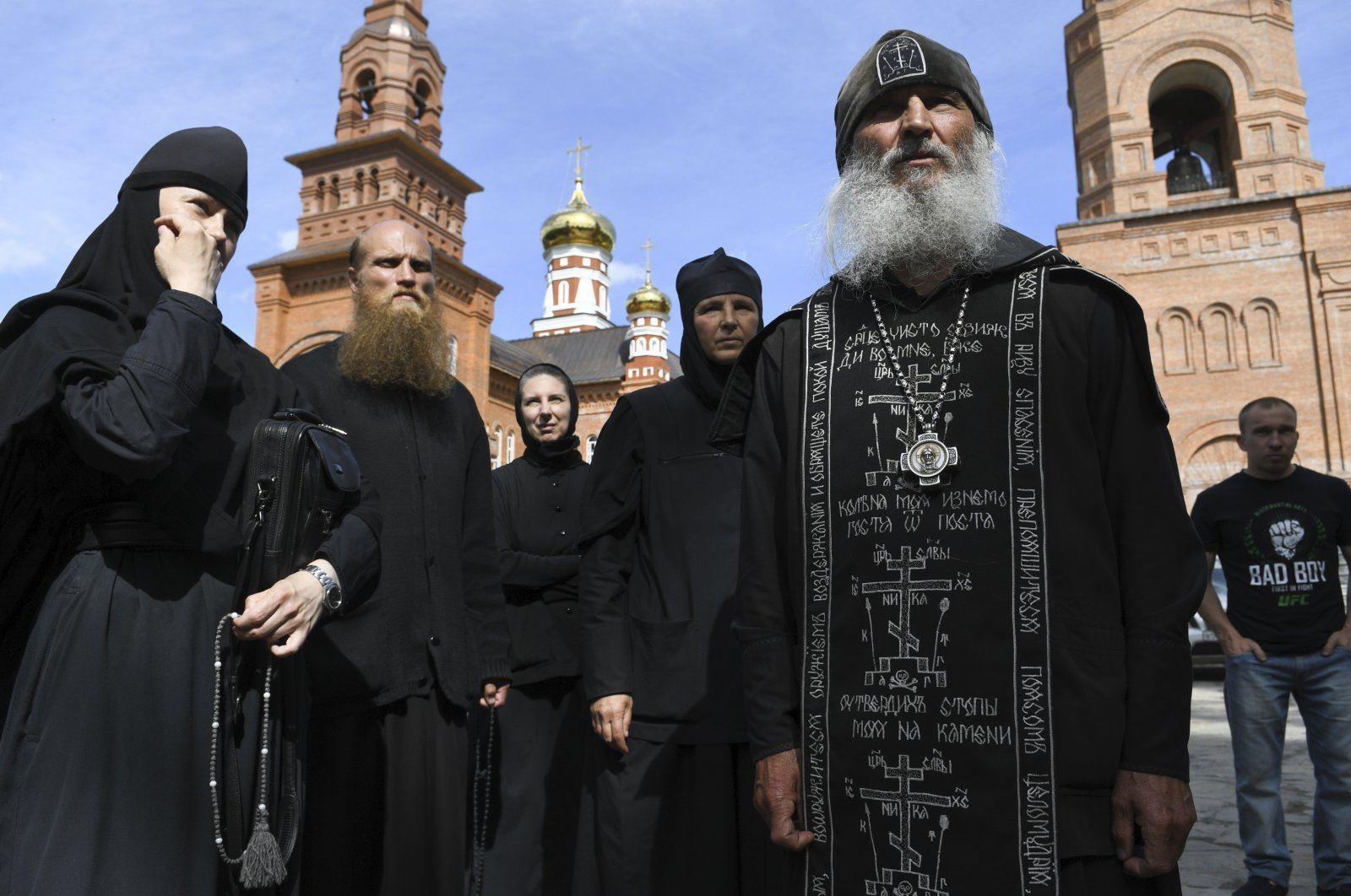 Father Sergiy (R), a Russian monk who defied the Russian Orthodox Church's leadership, speaks to journalists in Russia. Wednesday, June 17, 2020 (AP Photo)
