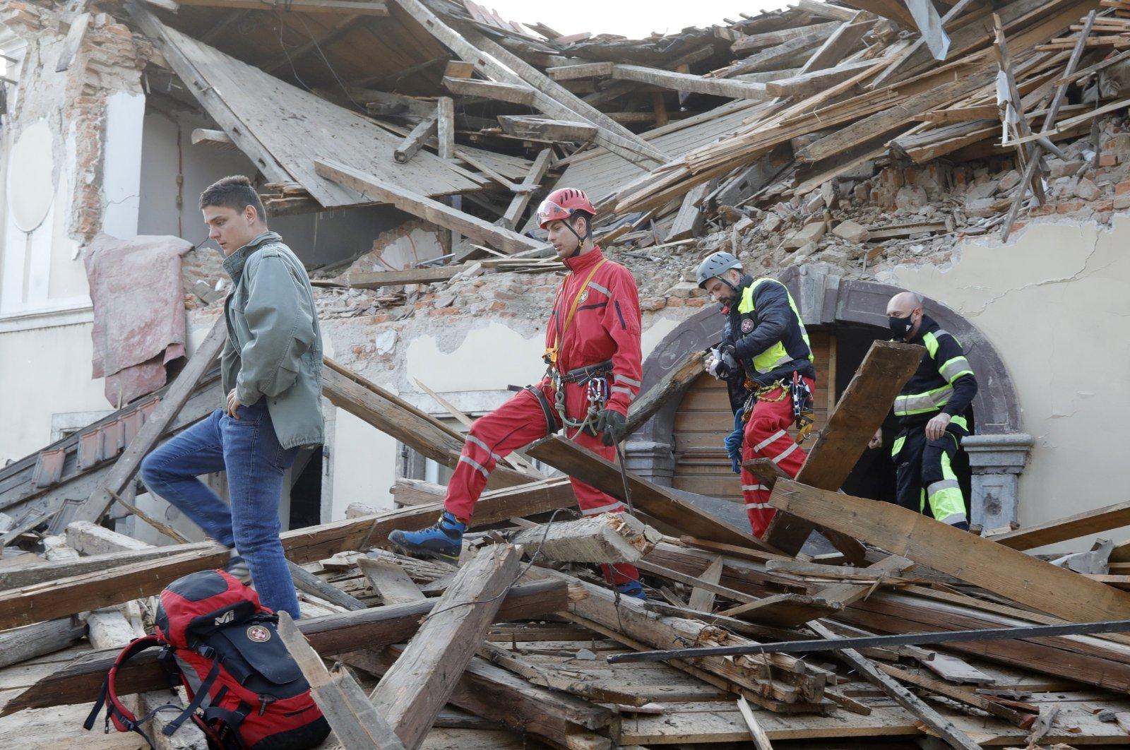 Workers clear a building damaged in an earthquake in Petrinja, Croatia, Dec. 29, 2020. (EPA Photo)