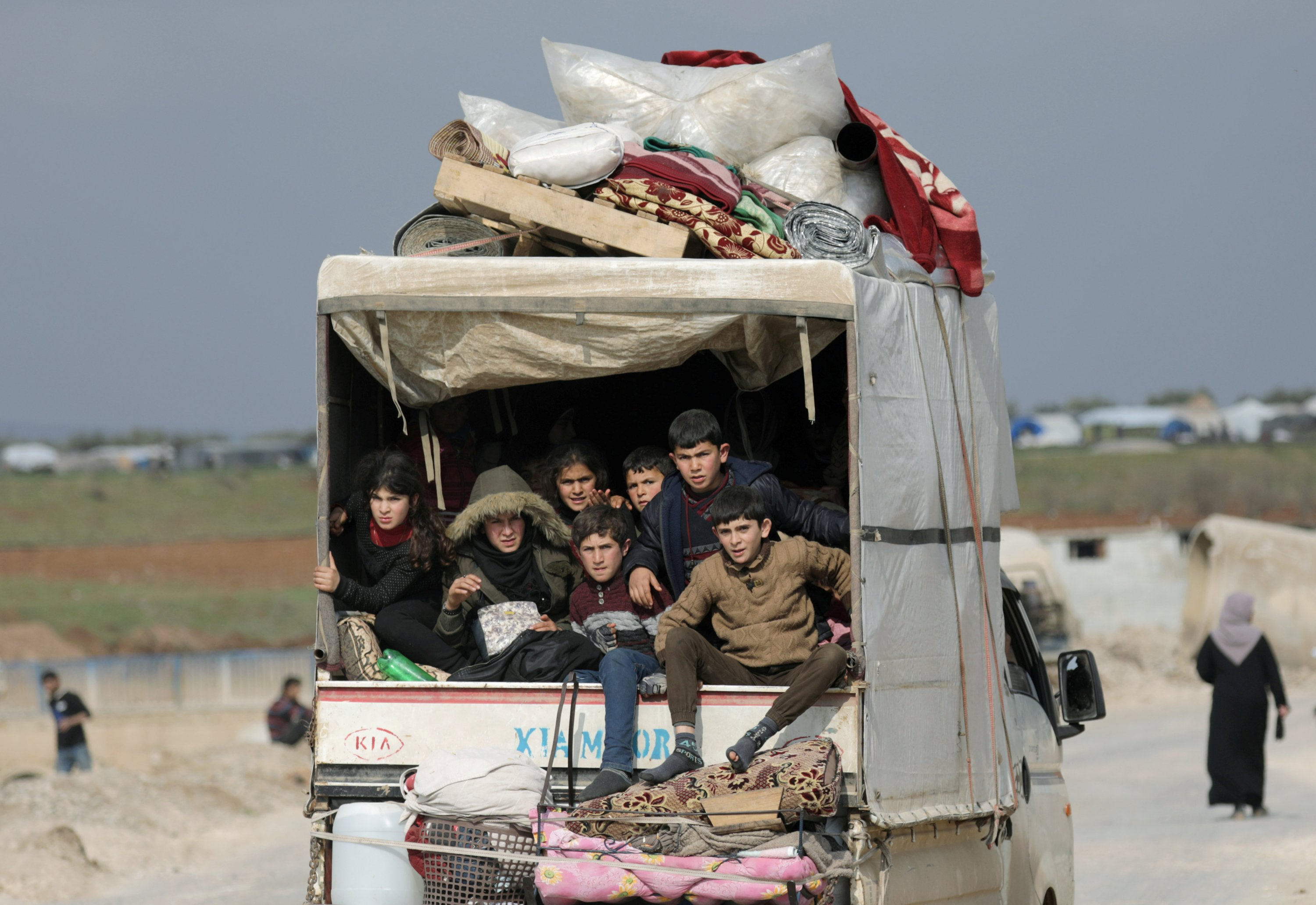 Internally displaced children ride in a pickup truck with their belongings in Afrin, northern Syria, Feb. 18, 2020. (Reuters Photo)