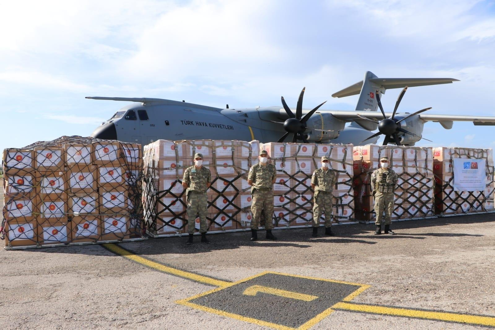 Turkish soldiers stand in front of a donation of medical supplies from Turkey to Somalia in the capital Mogadishu, Somalia, May 2, 2020. (AA Photo)