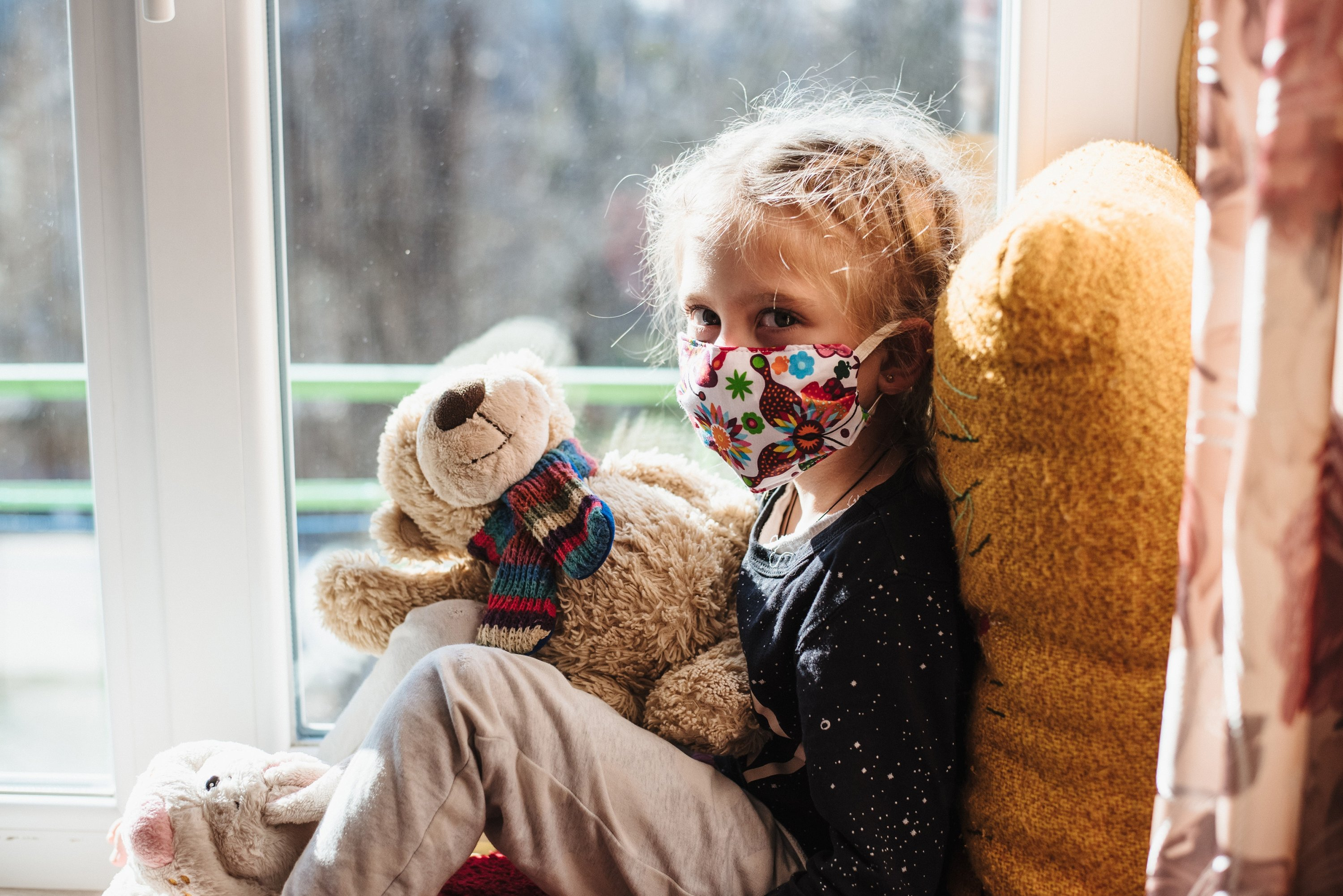 Letting children choose the color and fabric of their masks can be a good option to motivate them. (Shutterstock Photo)