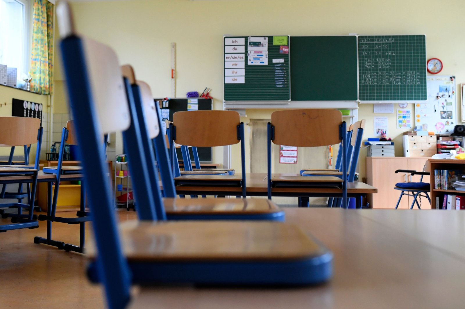 A picture shows chairs on tables at the Petri primary school, in Dortmund, western Germany, March 13, 2020  (AFP Photo)