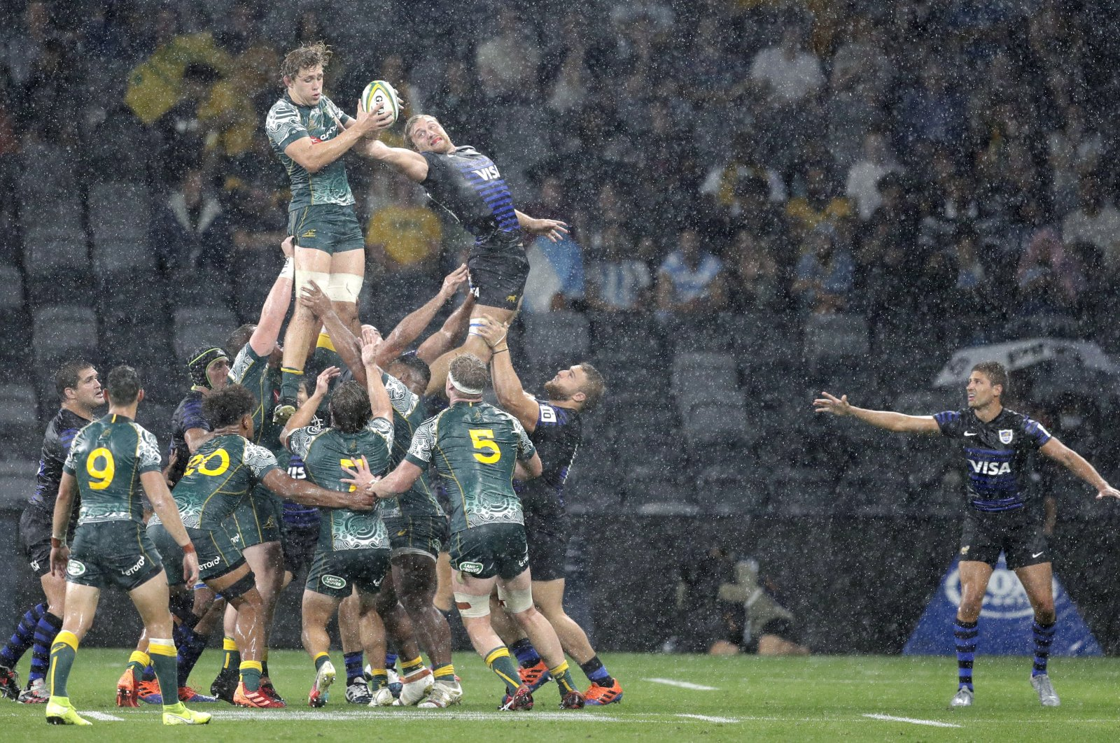 Australia and Argentina compete in a line out during their Tri-Nations rugby union match in Sydney, Australia, Dec. 5, 2020. (AP Photo)