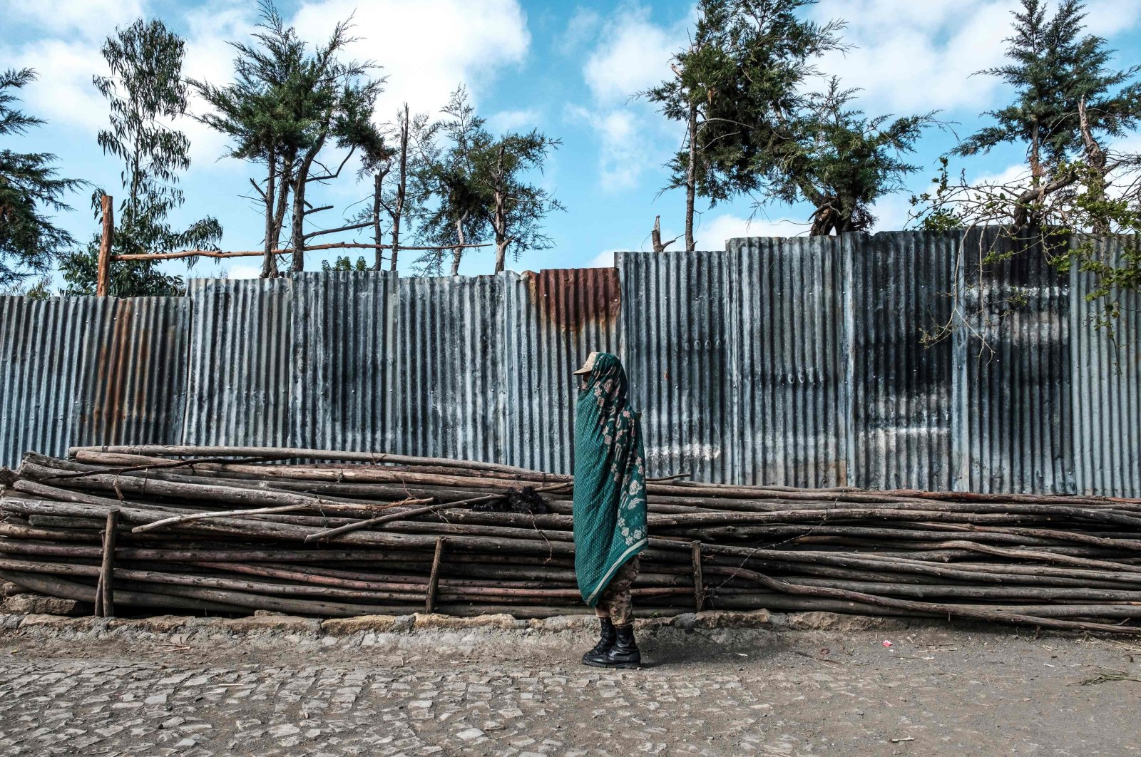 A member of the Amhara Special Forces, covered with a traditional blanket, stands in a street in the town of Korem, north of Alamata, Ethiopia, Dec. 12, 2020. (AFP Photo)