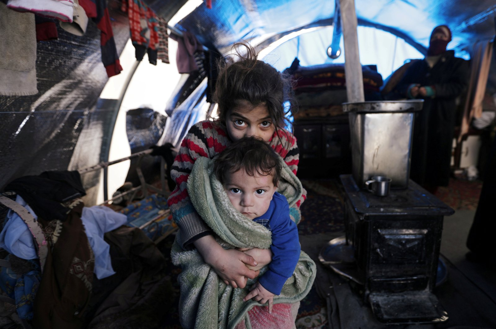 Internally displaced children who fled from the western Aleppo countryside sit inside a tent in Afrin, northwestern Syria, Feb. 14, 2020. (Reuters Photo)