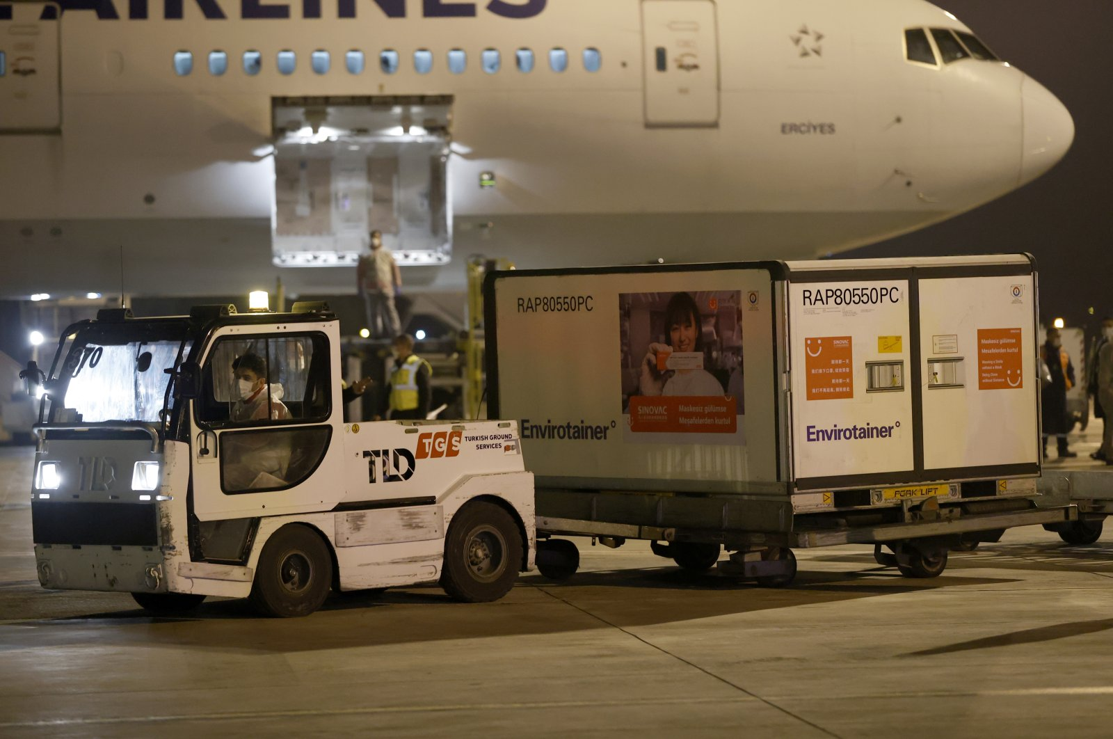 Workers at Esenboğa Airport haul a container carrying doses of Sinovac's COVID-19 vaccine, in Ankara, Turkey, Dec. 30, 2020. (AA Photo)