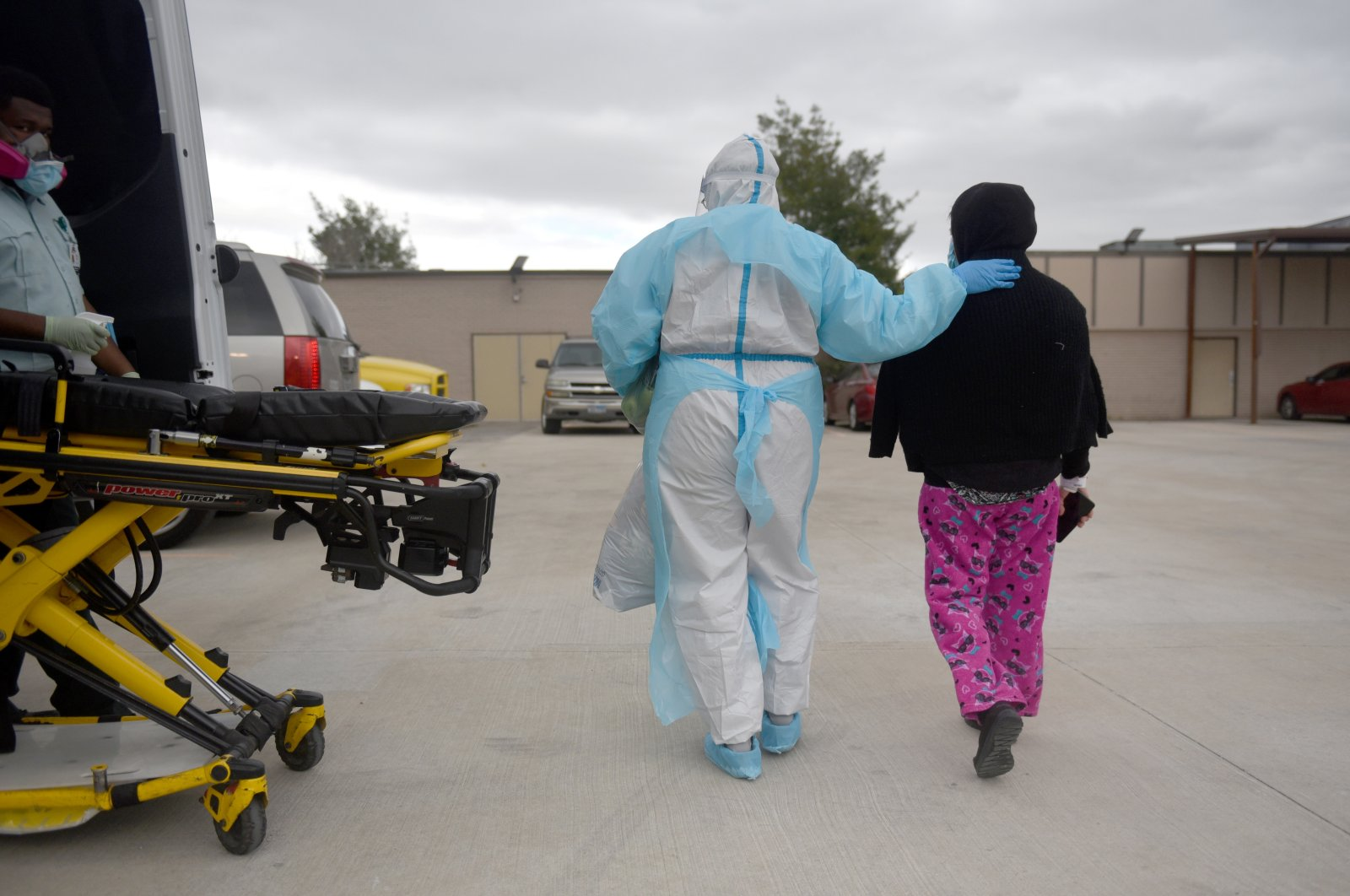 A health care worker walks with Juana Negrete, who is waiting to be picked up after being discharged from the COVID-19 unit at United Memorial Medical Center in Houston, Texas, U.S., Dec. 29, 2020. (Reuters Photo)