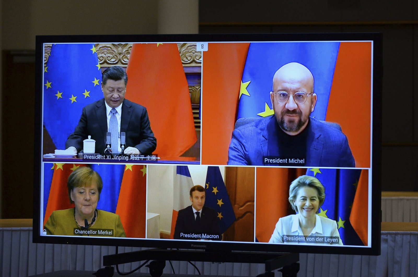 A screen displays live Chinese President Xi Jinping (top L), European Council President Charles Michel (top R), European Commission President Ursula von der Leyen (bottom R), French President Emmanuel Macron (bottom C) and German Chancellor Angela Merkel during an EU-China Leaders' meeting videoconference at the European Council headquarters in Brussels, Belgium, Dec. 30, 2020. (AP Photo)