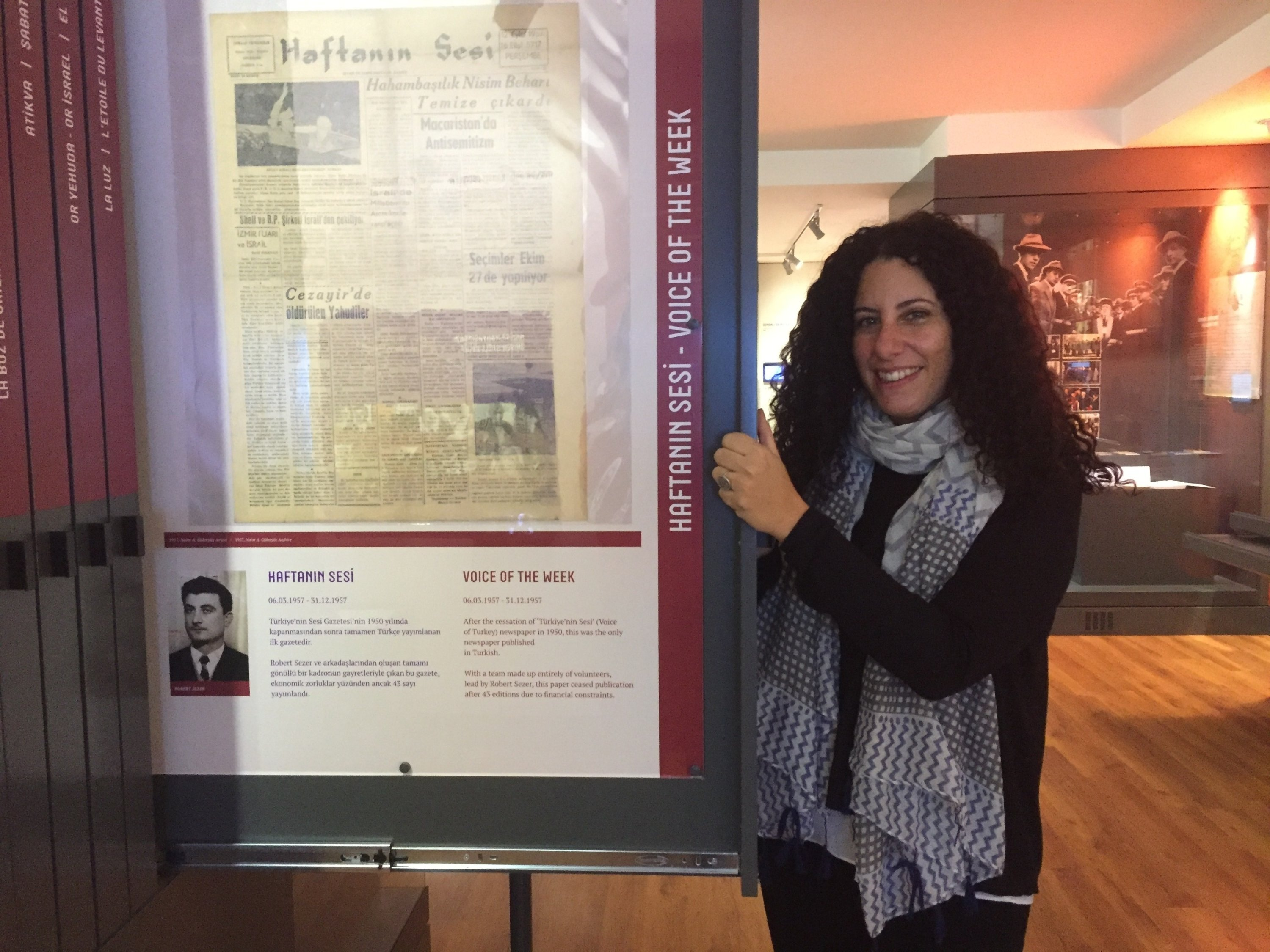 Nisya Isman Allovi, curator and director of the Jewish museum in Istanbul, Turkey, displays an old page from the Haftanin Sesi weekly newspaper. (Photo by Paris Achen)