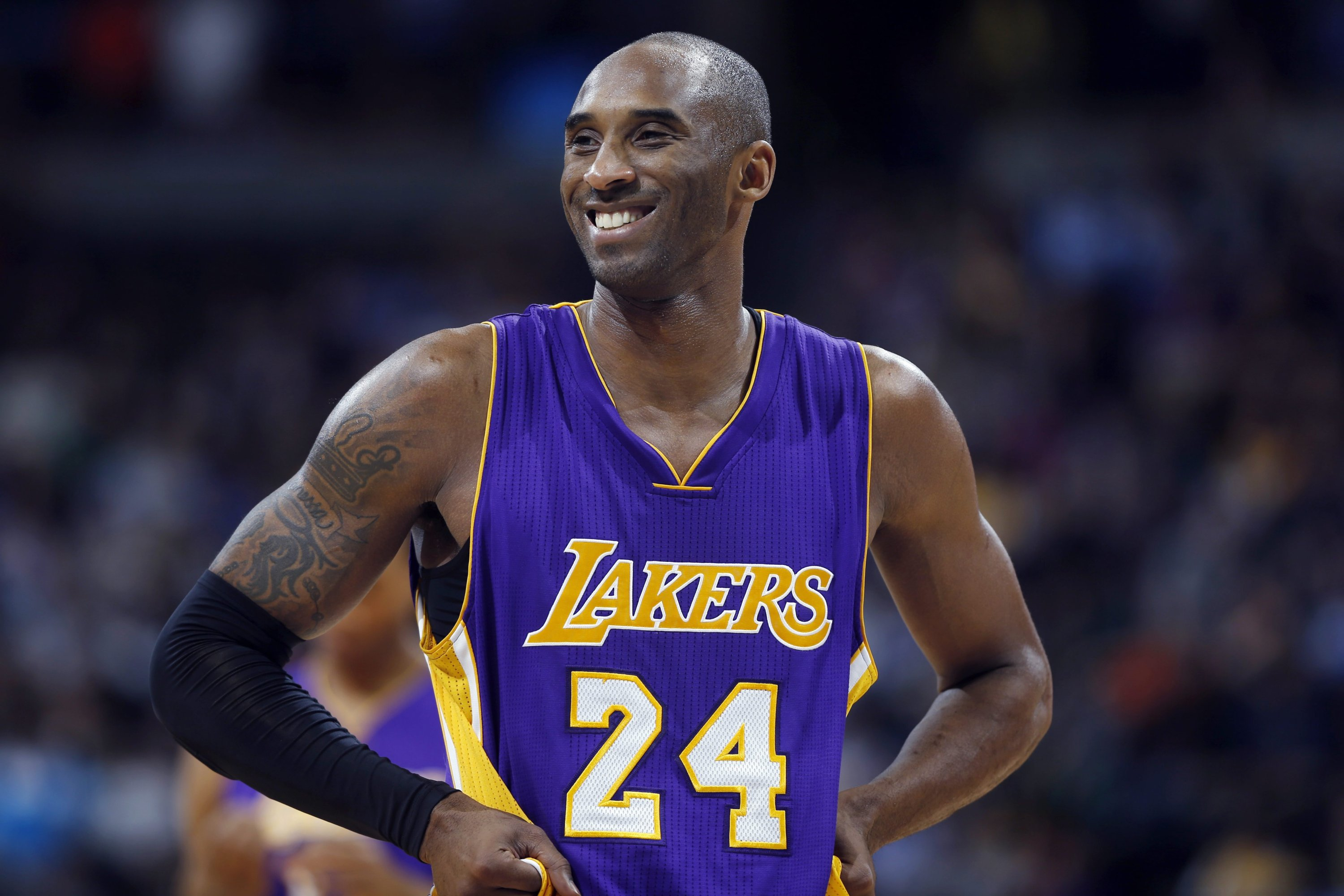 Los Angeles Lakers guard Kobe Bryant stands on the court during a review in the fourth quarter of an NBA basketball game against the Denver Nuggets in Denver, Colorado, U.S., Dec. 30, 2014. (AP Photo)