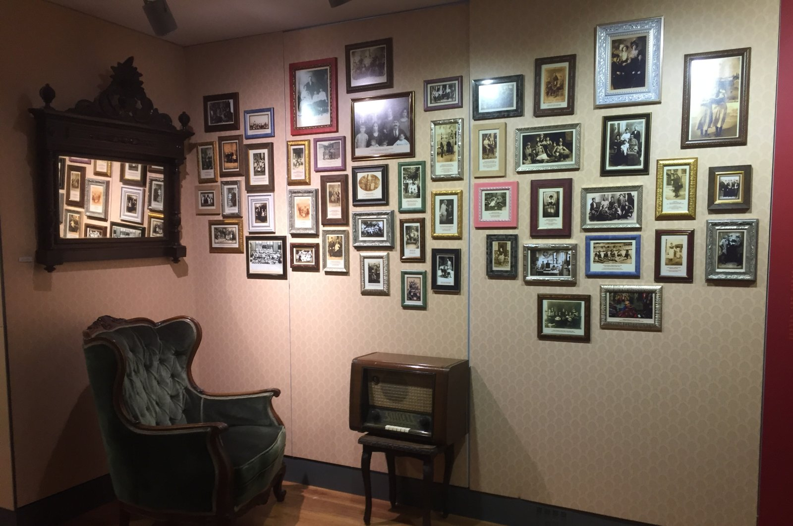 This recreated home parlor features family photographs of Turkey's Jews through the decades, at the Jewish museum in Istanbul, Turkey. (Photo by Paris Achen)