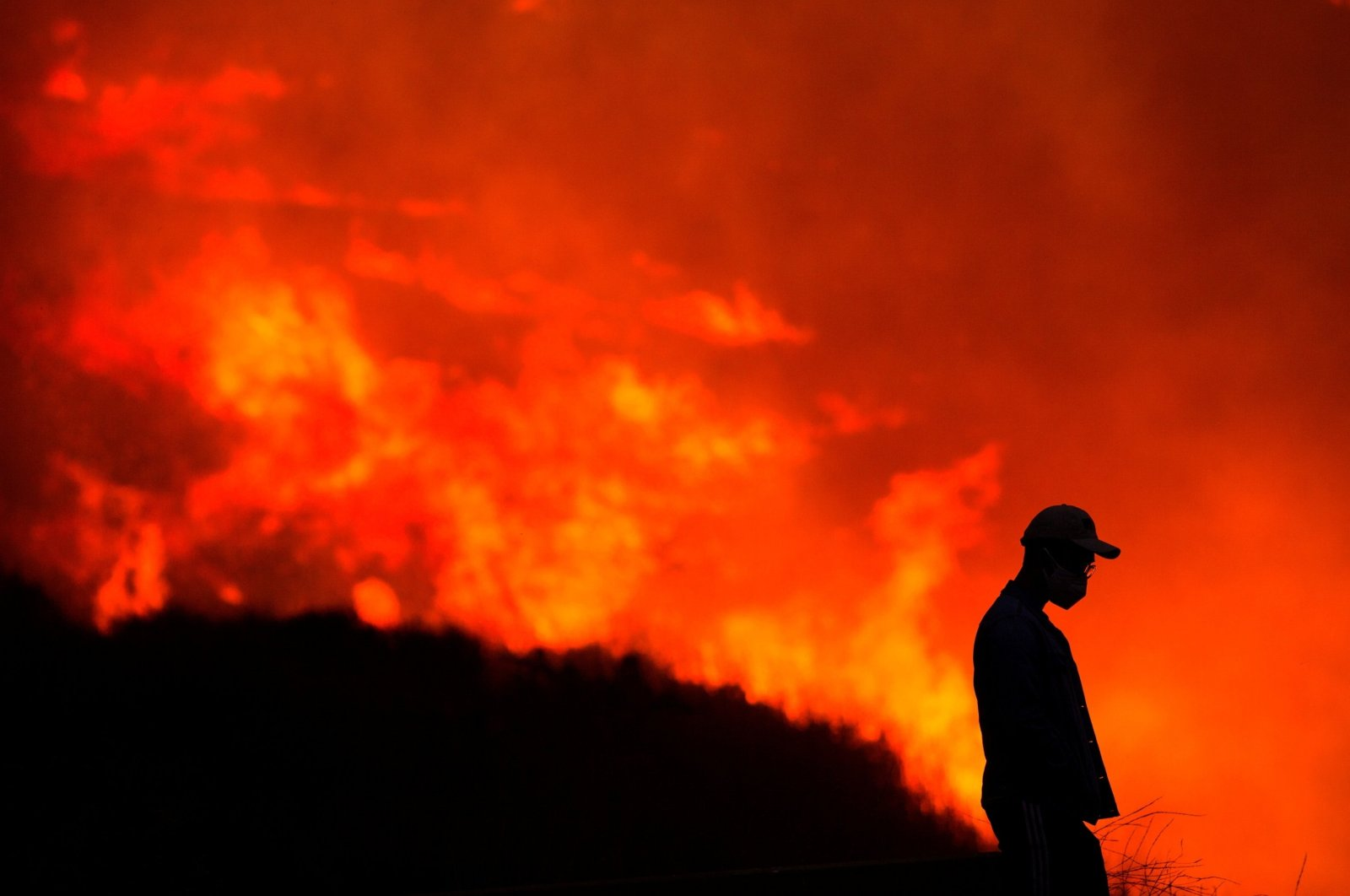 A silhouette of a man is seen as he watches the Blue Ridge Fire burning in Yorba Linda, California, U.S., Oct. 26, 2020. (Reuters Photo)