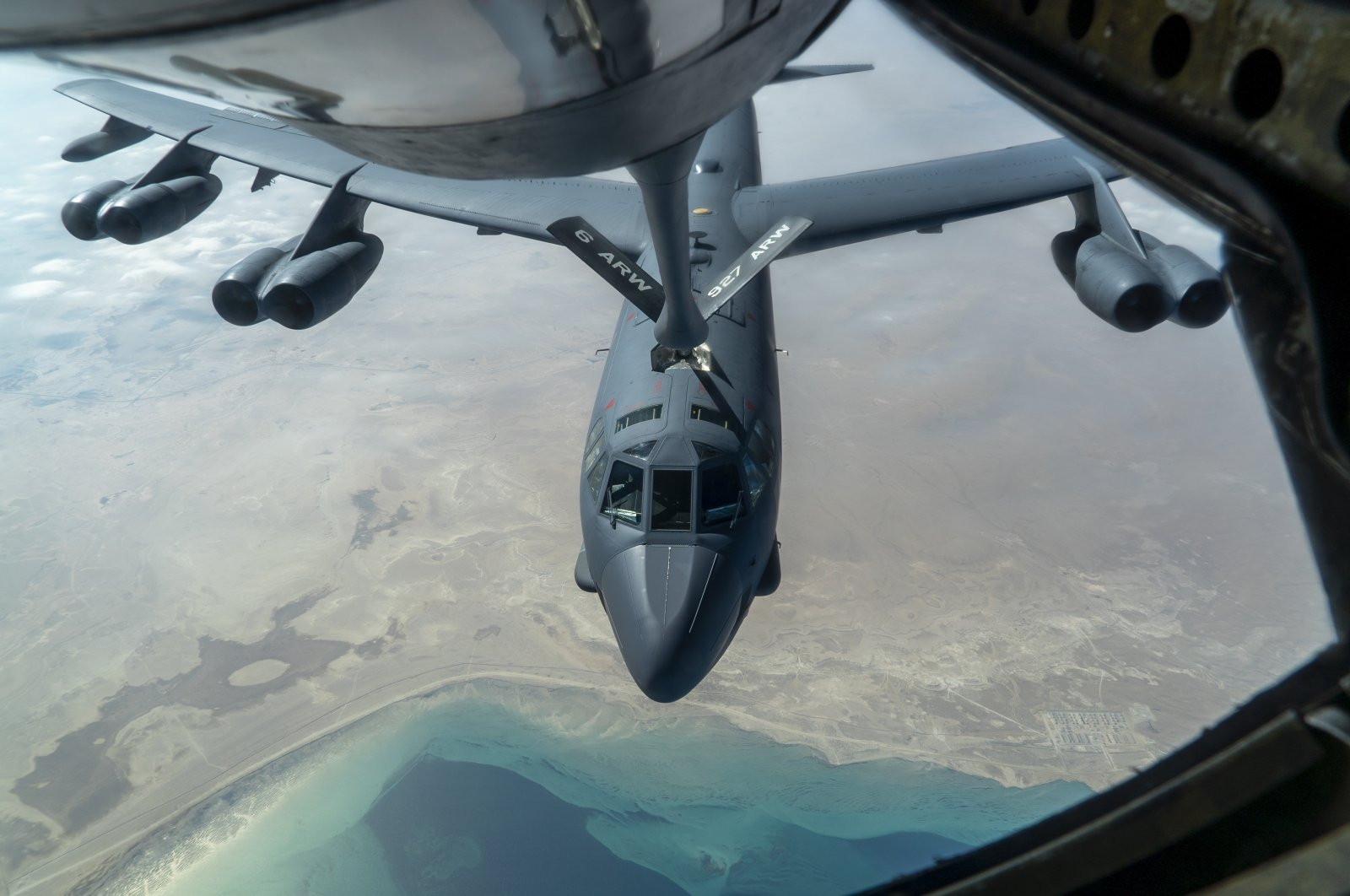 "A U.S. Air Force B-52H ""Stratofortress"" from Minot Air Force Base, N.D., is refueled by a KC-135 ""Stratotanker"" in the U.S. Central Command area of responsibility, Dec. 30, 2020. (AP Photo)"