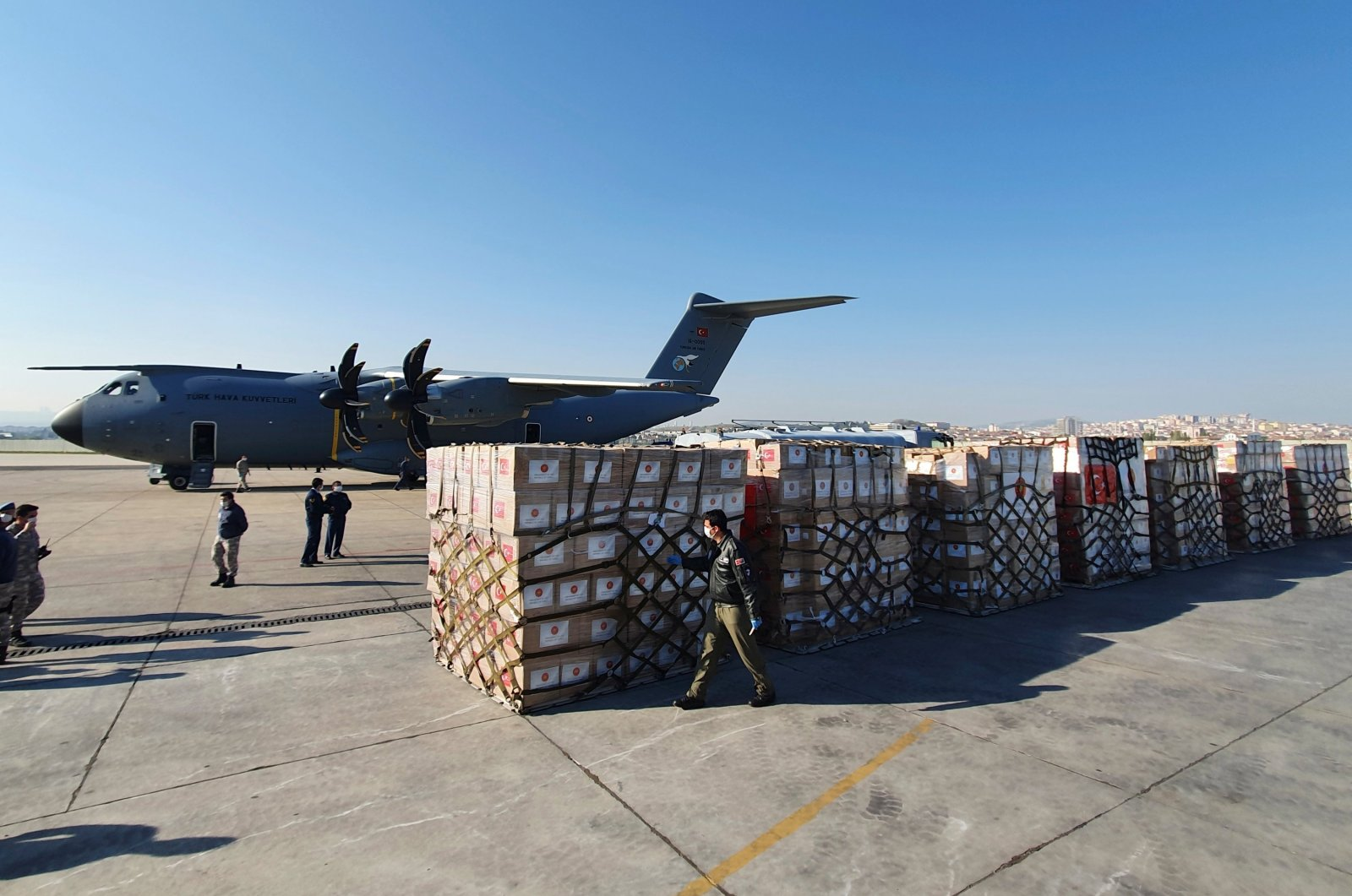 Turkish soldiers prepare to load a military cargo plane with Personal Protection Equipment donated by Turkey to help United States combat the new coronavirus outbreak, at the Etimesgut airport outside Ankara, Turkey, April 28, 2020. (AP Photo)