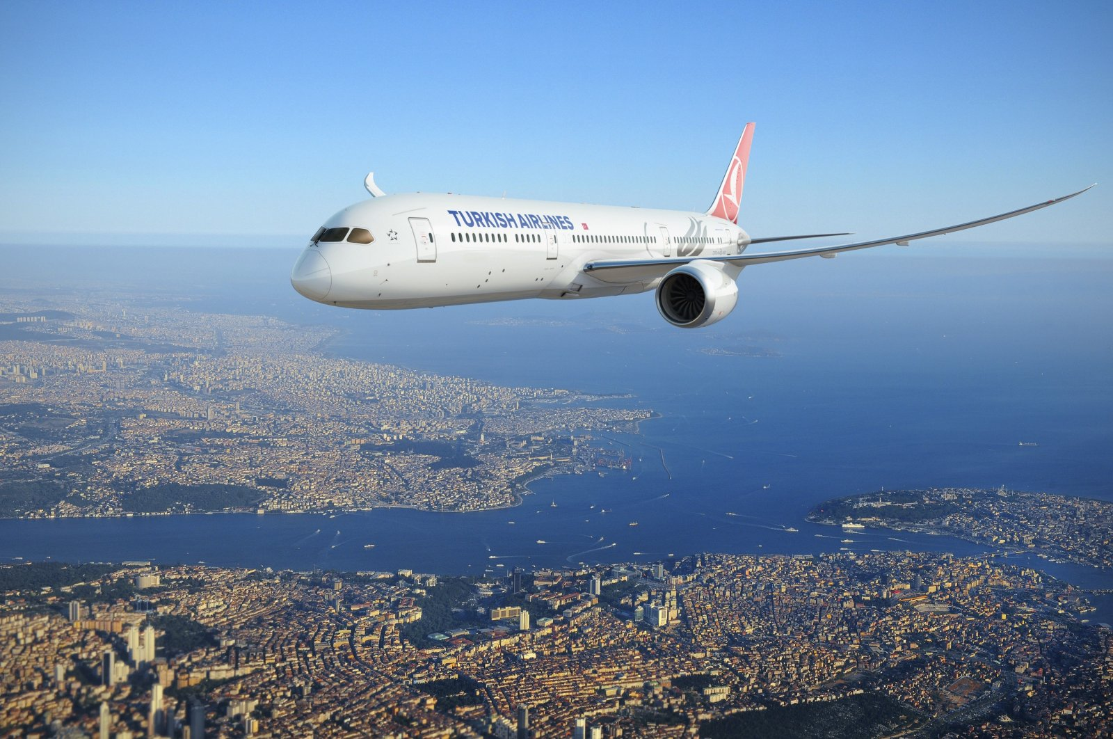 A THY plane seen over the skies of Istanbul in this photo provided on Dec. 31, 2020. (Photo by THY via IHA)