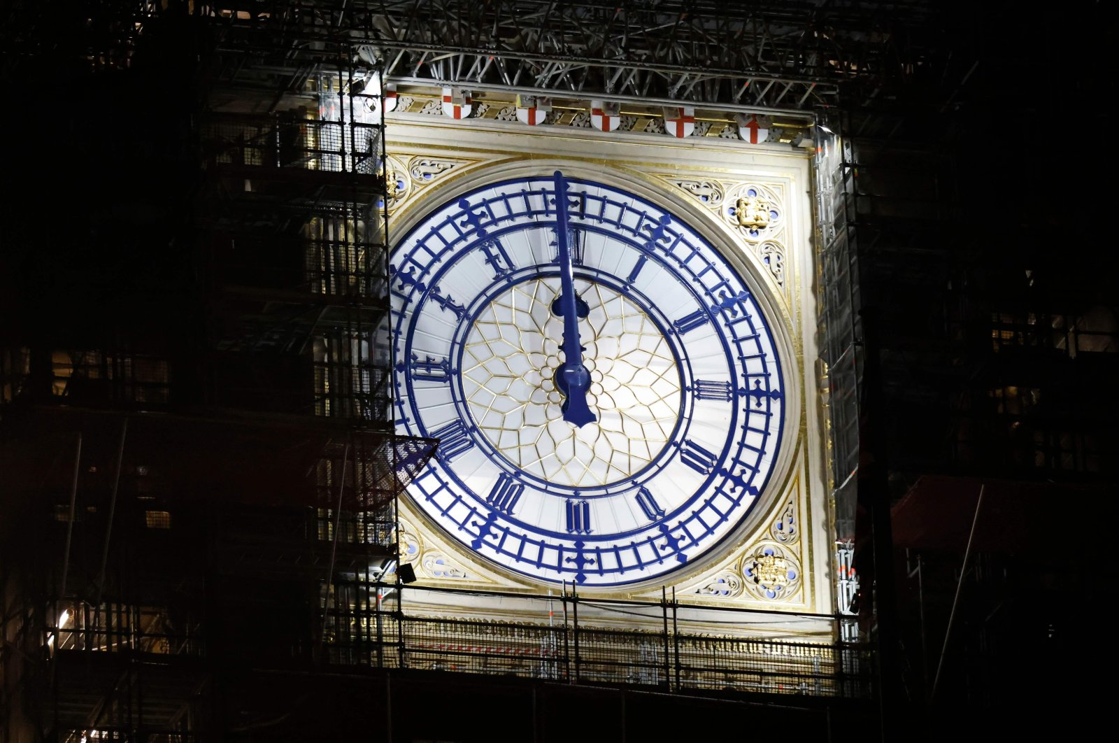The clock-face on the Elizabeth Tower, known as Big Ben, shows midnight early on New Year's Day, Jan. 1, 2021, in London. (AFP Photo)