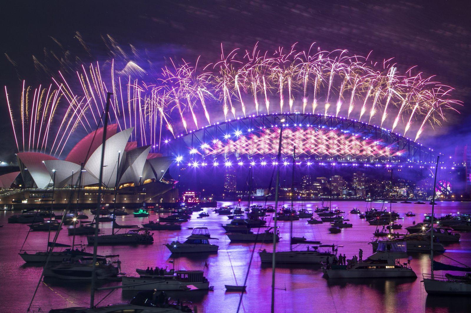 Fireworks explode over the Sydney Opera House and Harbour Bridge as New Year's celebrations begin in Sydney, Australia, Dec. 31, 2020. (AP Photo)