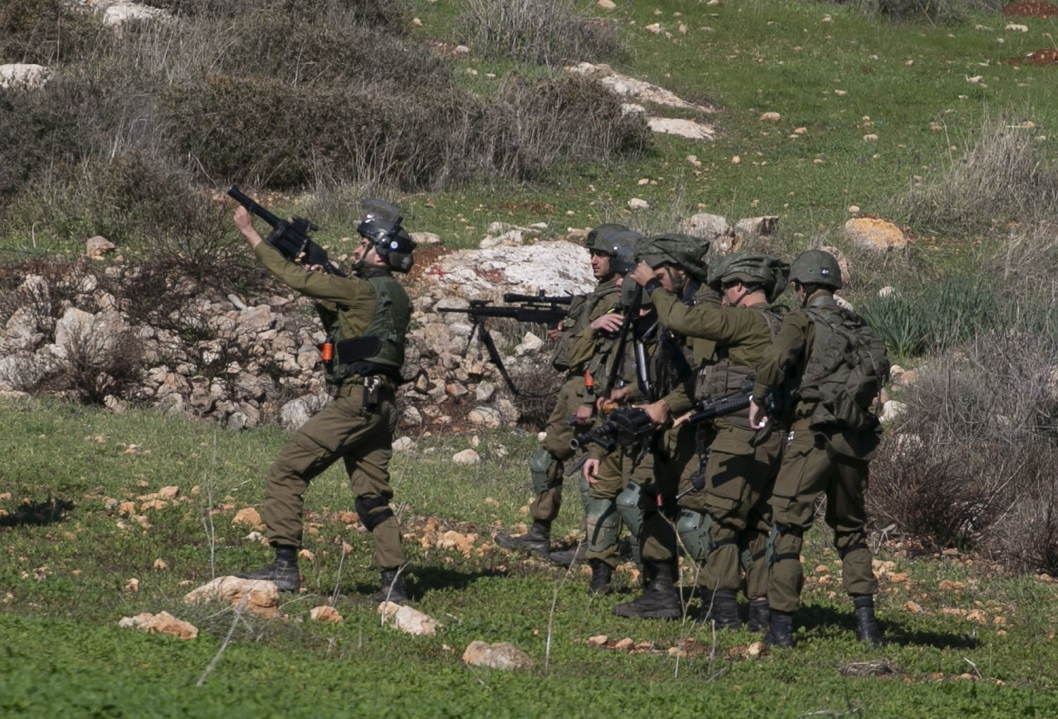 Israeli soldiers take aim to disperse Palestinians protesting the expansion of settlements near the village of Beit Dajan, east of Nablus, in the occupied West Bank, on Dec. 25, 2020. (AFP Photo)