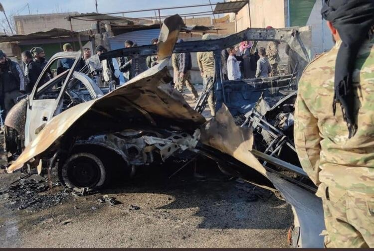 This image obtained from video footage shows the debris after a car bomb exploded in the Syrian town of Ras al-Ain on Jan. 2, 2021 (DHA Photo)