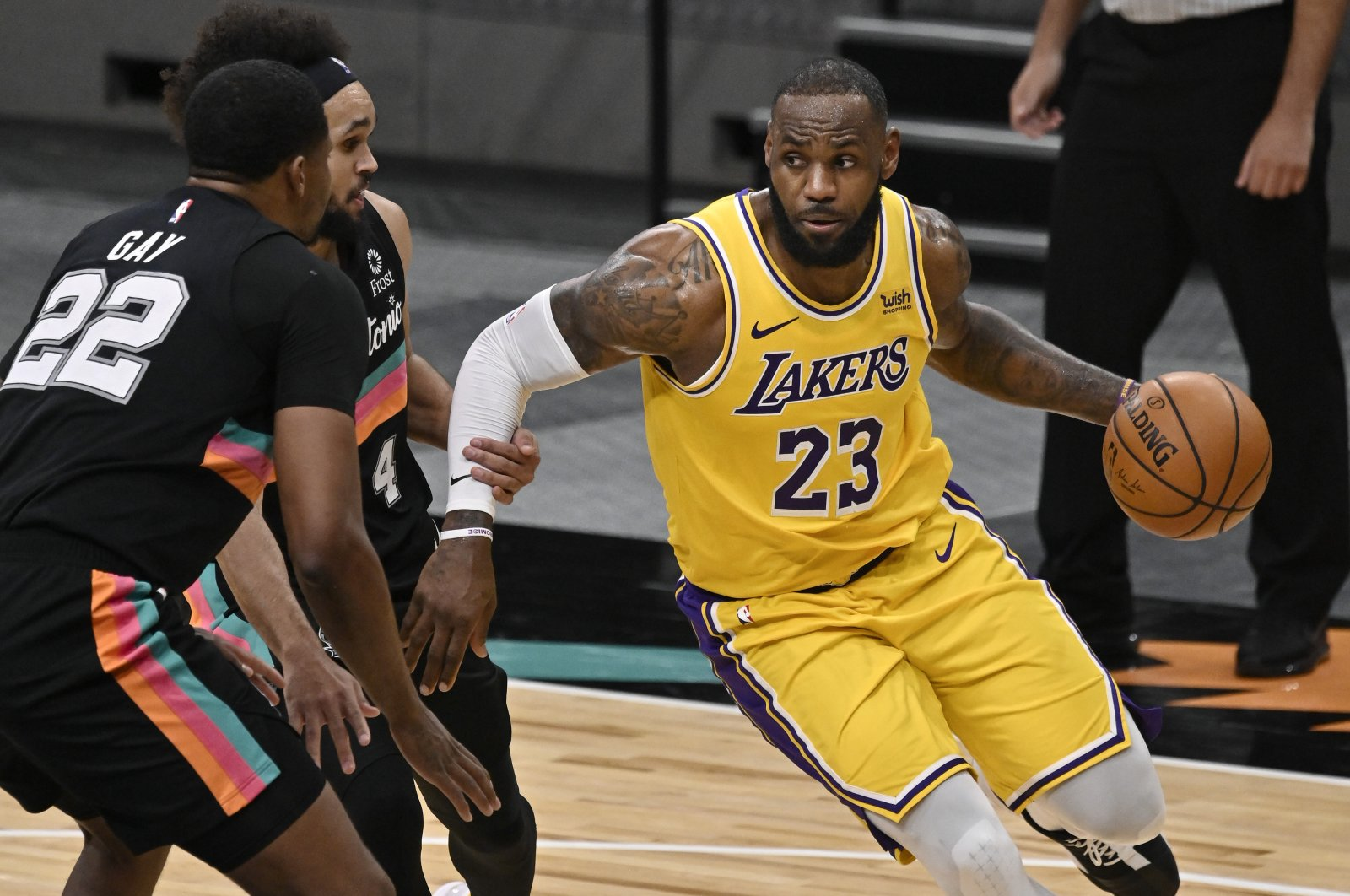 Los Angeles Lakers' LeBron James (23) drives against San Antonio Spurs' Rudy Gay (22) and Derrick White during the second half of an NBA basketball game Friday, Jan. 1, 2021, in San Antonio. (AP Photo)
