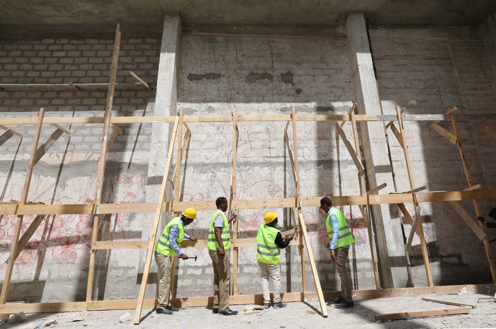 Construction workers take part in the renovation project of Somalia's National Theatre in Mogadishu, Somalia, Feb. 3, 2019.  (Reuters File Photo)