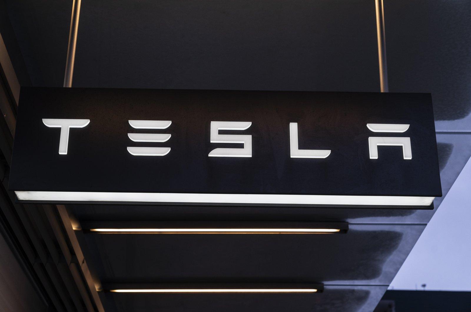 View of Tesla company logo at the entrance of dealership on Washington Street in New York, Dec. 20, 2020. (Lev Radin/Sipa USA via Reuters)