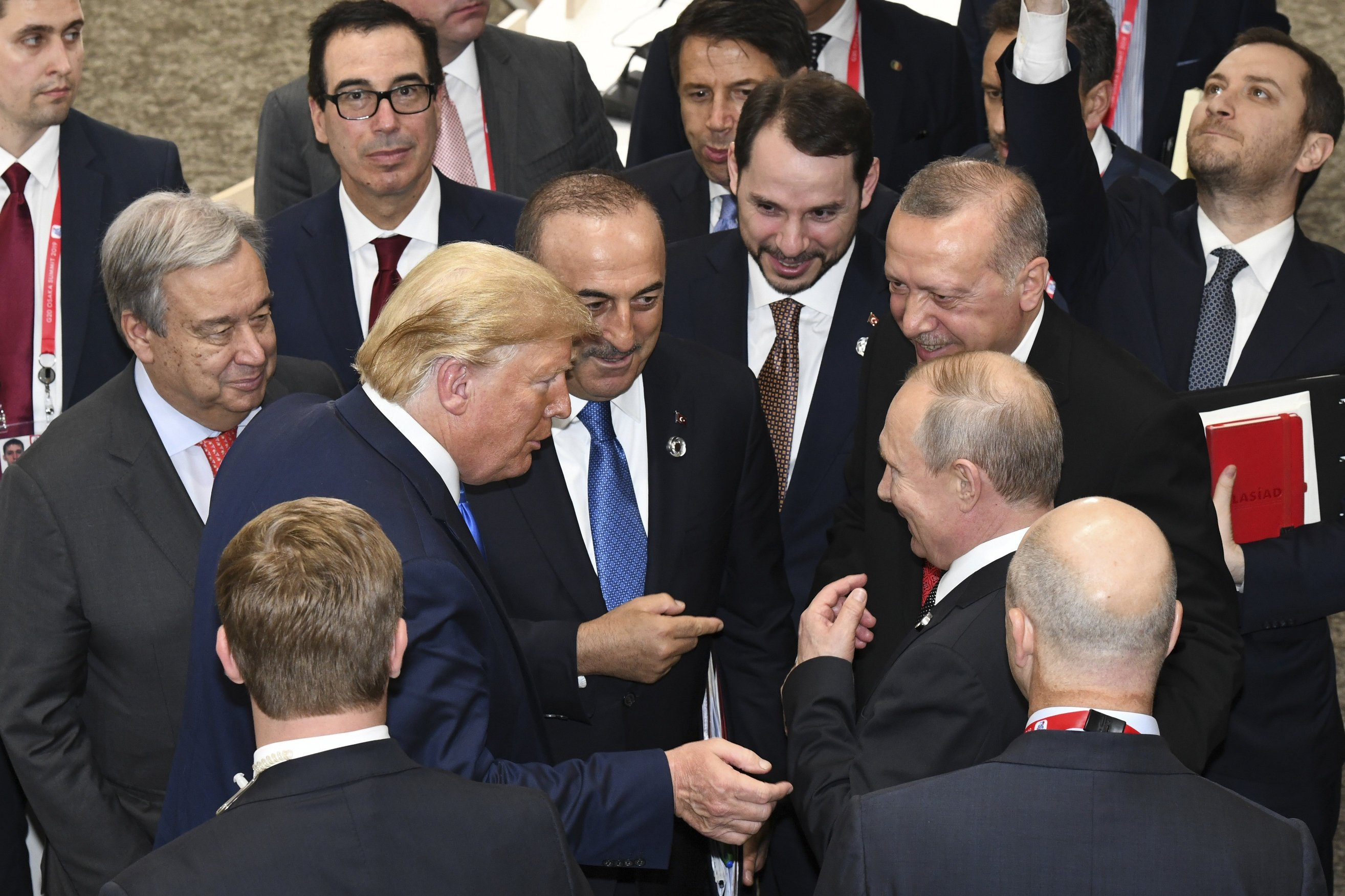 U.S President Donald Trump, center left, talks with Russian President Vladimir Putin, center right, as President Recep Tayyip Erdoğan, second right, and United Nations Secretary-General Antonio Guterres, second left, look on, on the sidelines of the G-20 summit in Osaka, Japan, June 29, 2019.
