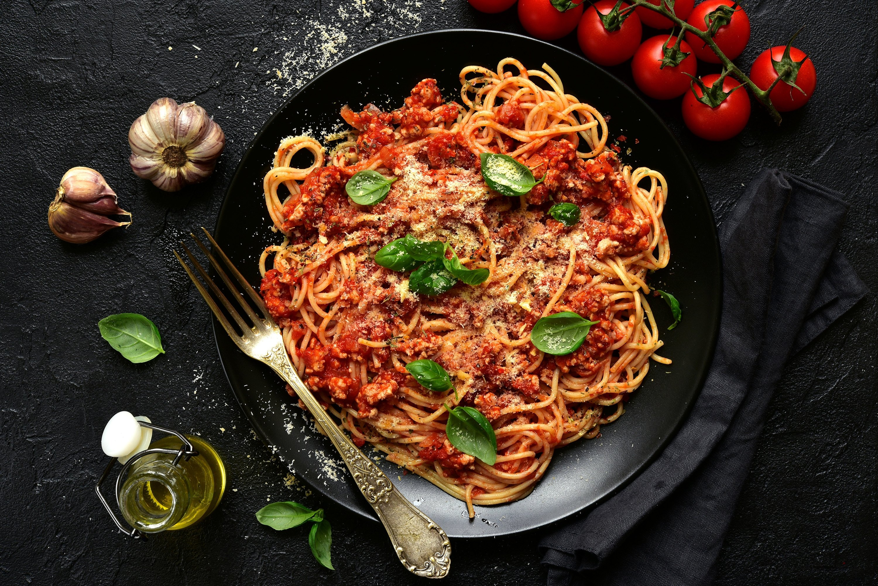 Fresh basil leaves and plenty of parmesan are a great way to top off bolognese. (Shutterstock Photo)