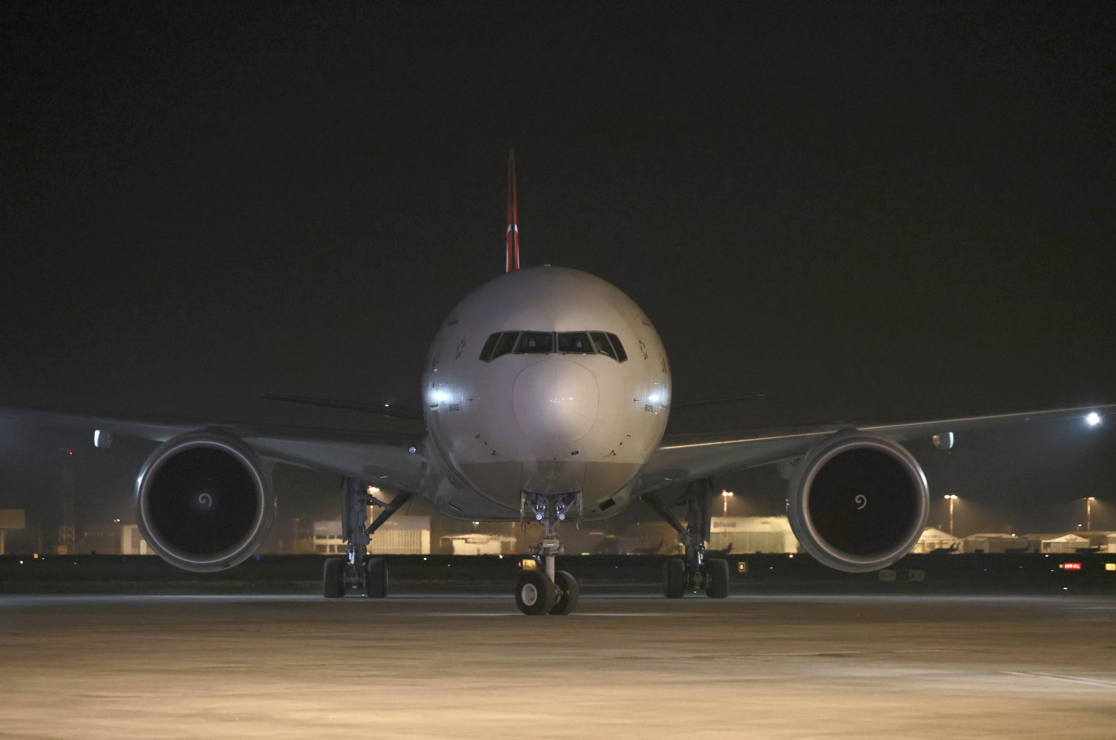 A Turkish Airlines plane loaded with the first batch of COVID-19 vaccine, CoronaVac, lands at Esenboğa Airport, in the capital Ankara, Turkey, Dec. 30, 2020. (Turkish Health Ministry via AP)