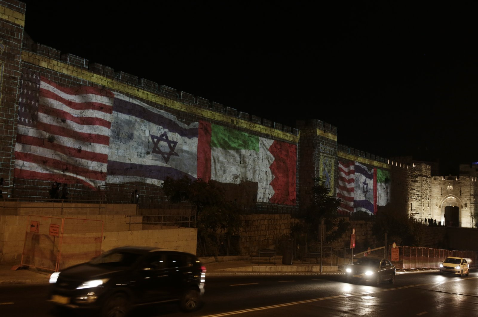Representations of the U.S., Israeli, Emirati and Bahraini flags are projected onto a wall, marking the day of a signing ceremony in Washington signifying the two Gulf nations' normalization with Israel, Jerusalem, Sept. 15, 2020. (AP Photo)