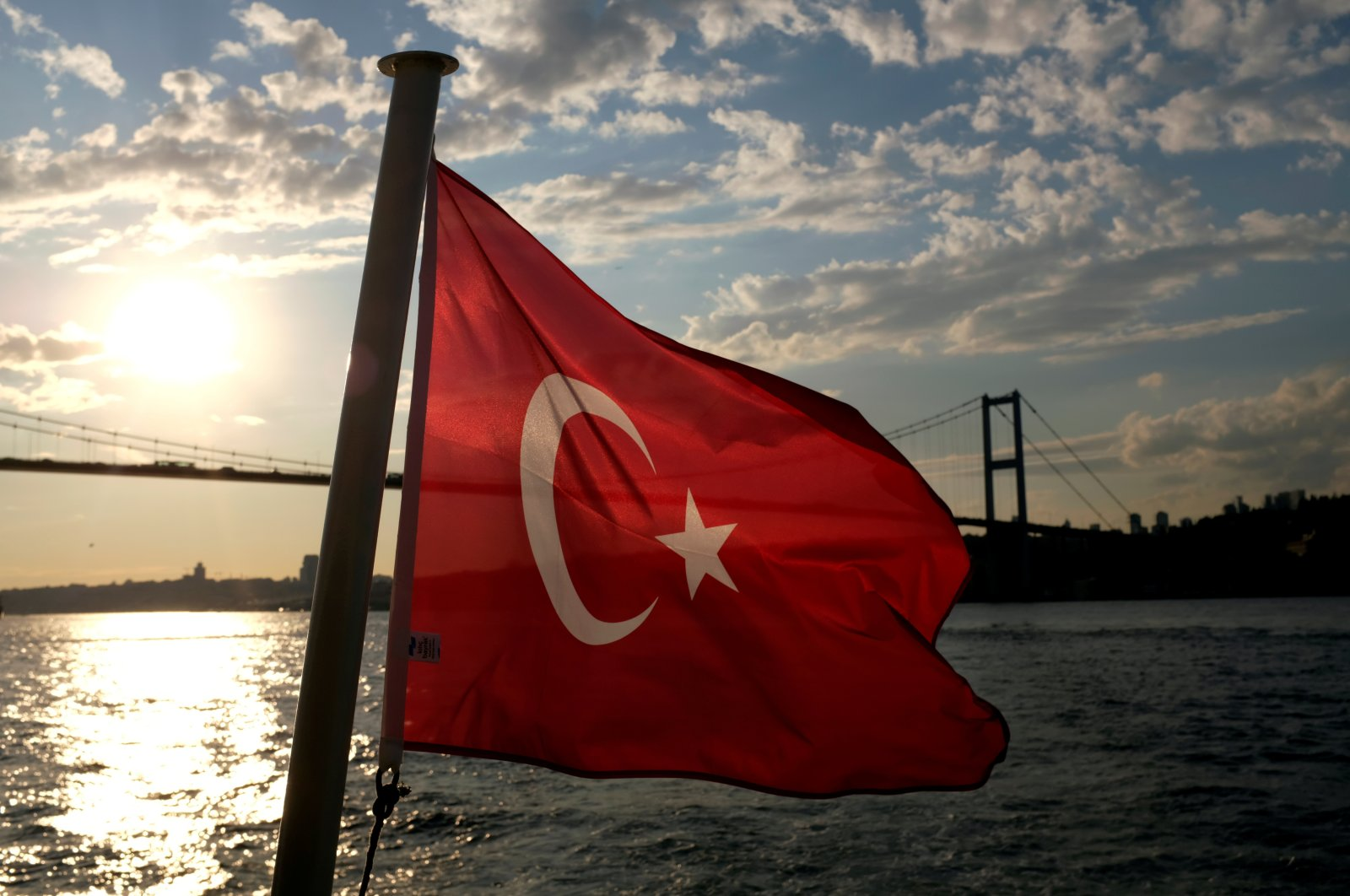A Turkish flag with the July 15 Martyrs Bridge in the background, flies on a passenger ferry in Istanbul, Turkey, Sept. 30, 2020. (Reuters Photo)