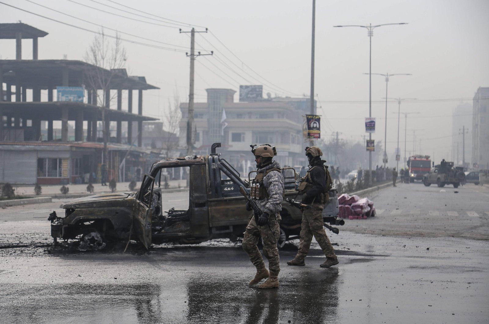 Members of Afghan security forces stand at the site of an attack in Kabul, Dec. 20, 2020. (AFP Photo)