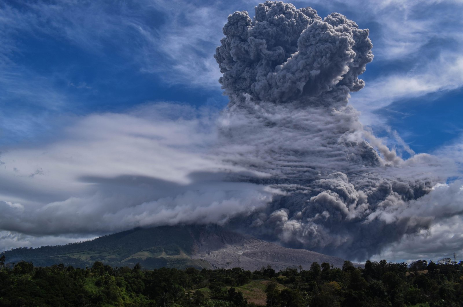 Mount Sinabung spews thick ash and smoke into the sky in Karo, North Sumatra on Aug. 10, 2020. (AFP Photo)