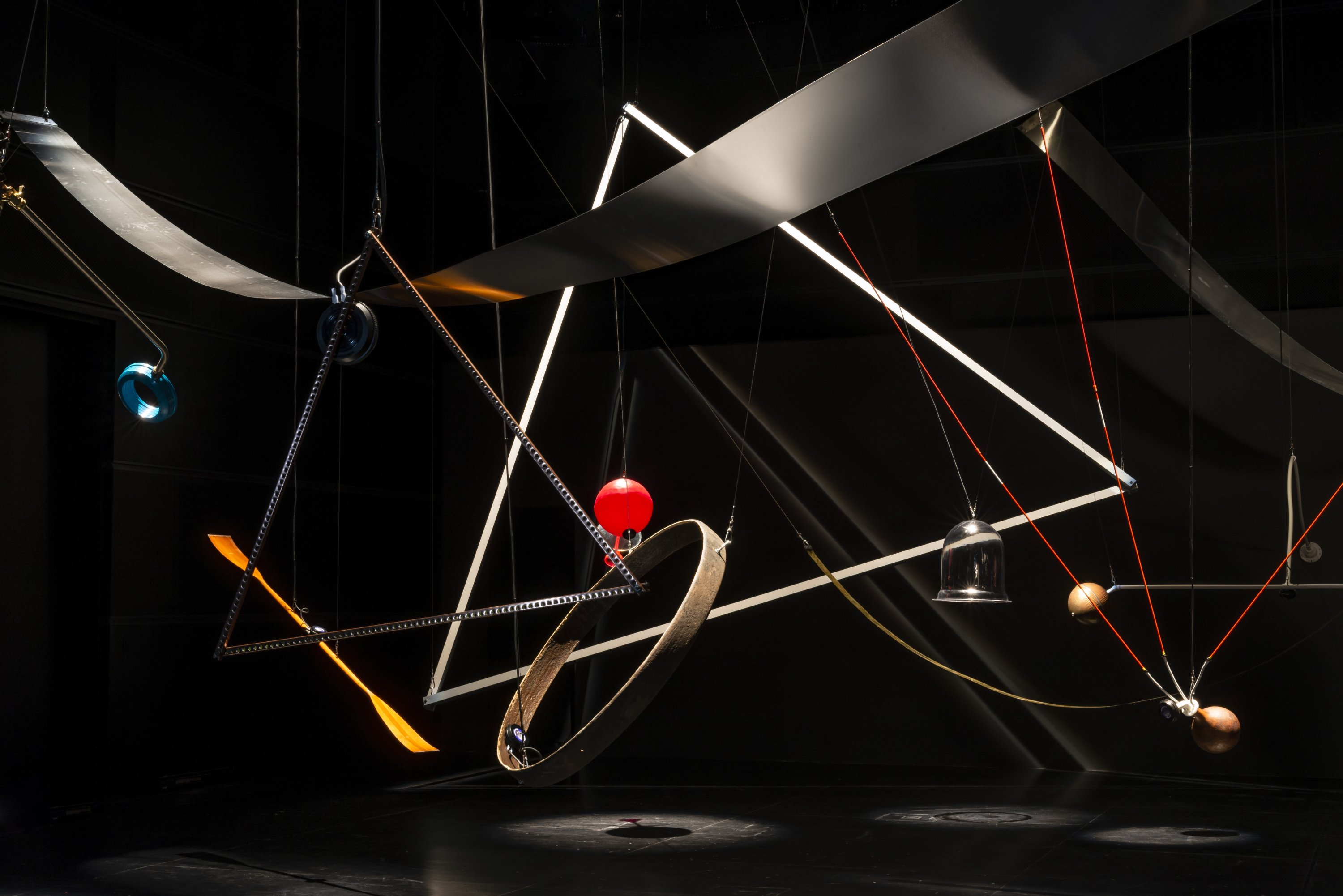 Twenty found and constructed objects hang from the tall ceiling at Arter as part of