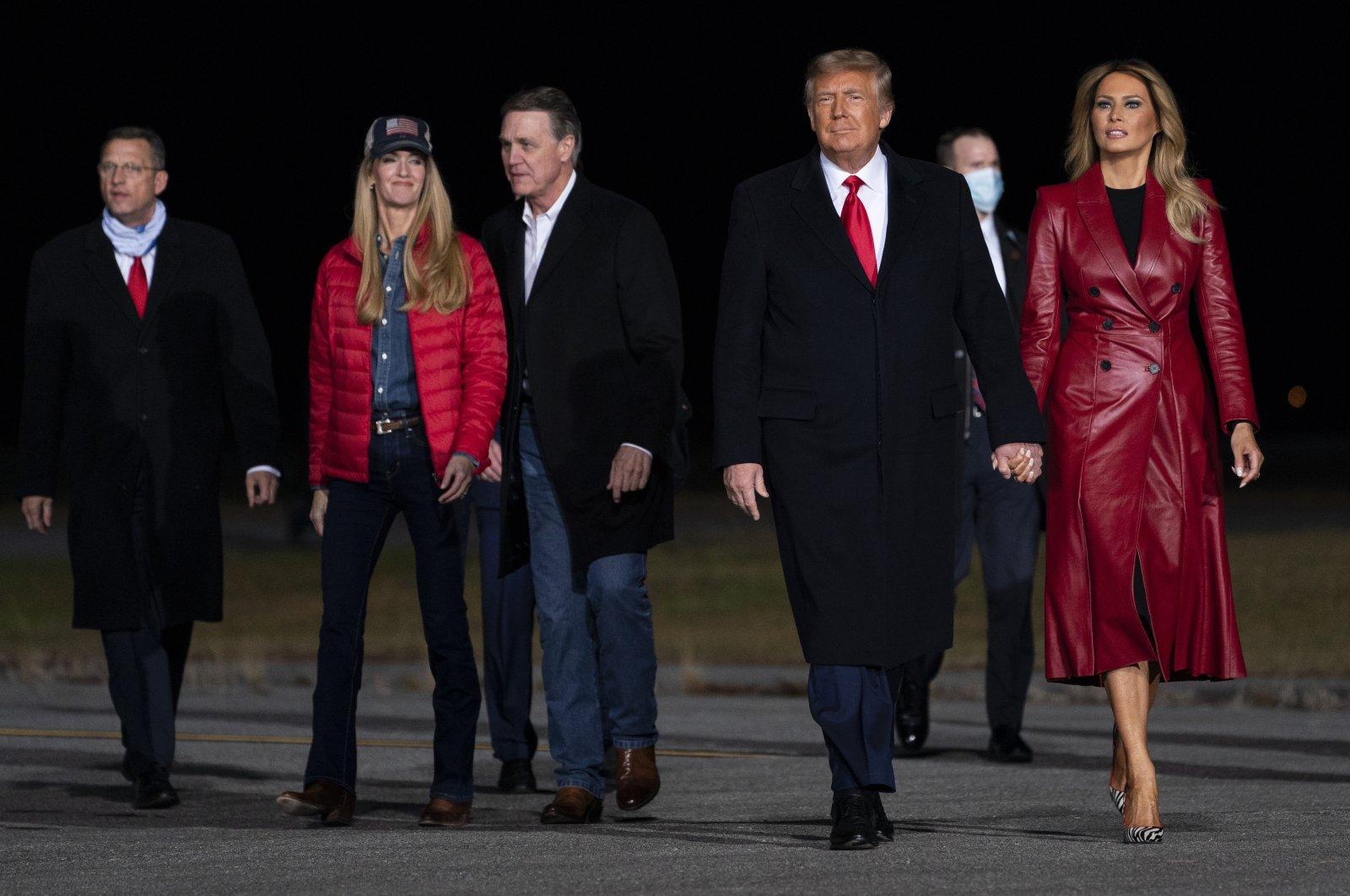U.S. President Donald Trump and first lady Melania Trump (R) arrive with Sen. Kelly Loeffler, R-Ga., (L) and Sen. David Perdue, R-Ga., (C) to a campaign rally for Senate Republican candidates, at Valdosta Regional Airport, in Valdosta, Georgia, U.S., Dec. 5, 2020. (AP Photo)