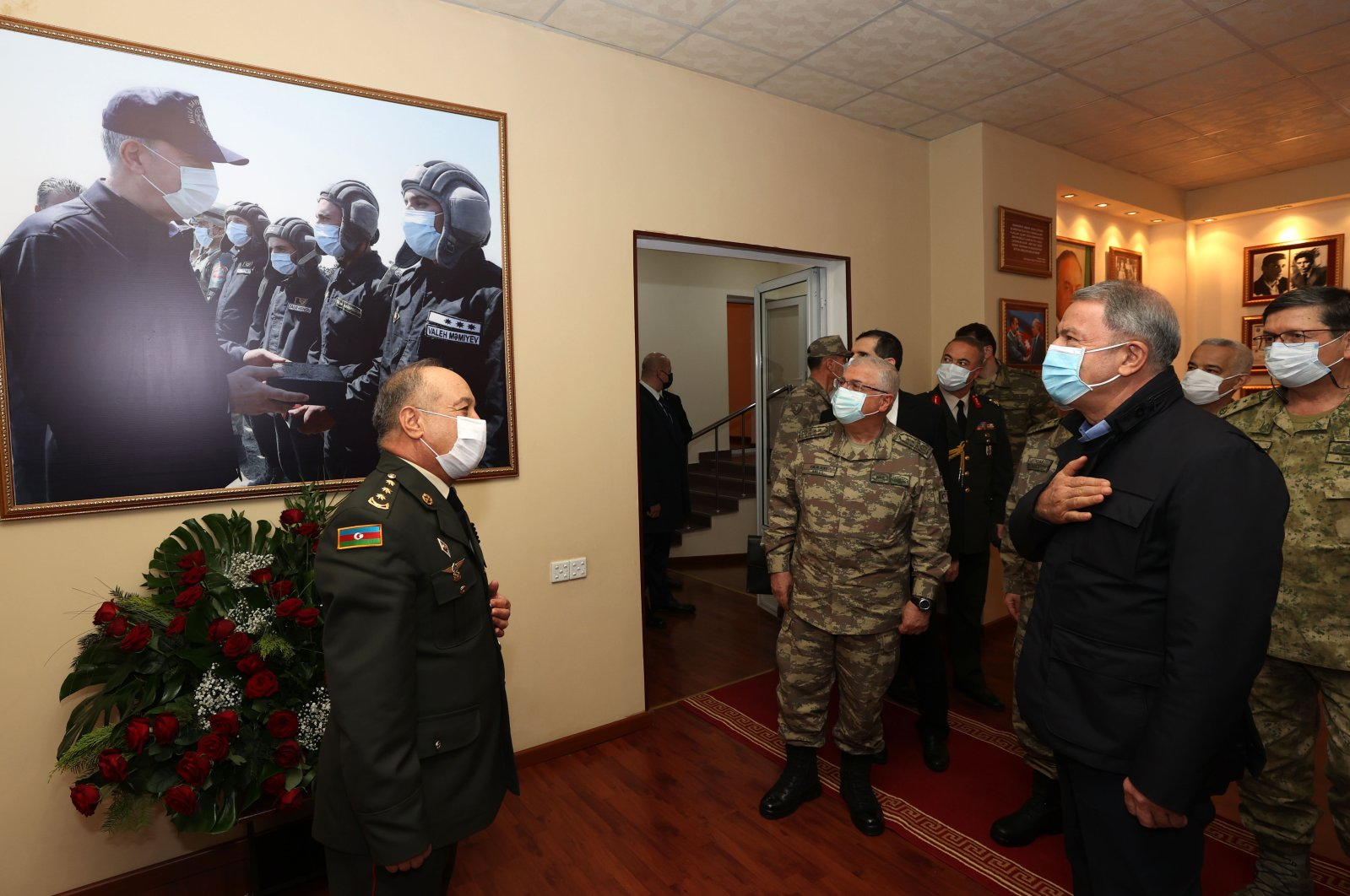 Turkish Defense Minister Hulusi Akar (R) looks at a picture of himself with Lt. Valeh Memiyev, who was killed during the recent Karabakh war, in the capital Baku, Azerbaijan, Jan. 3, 2021. (AA Photo)