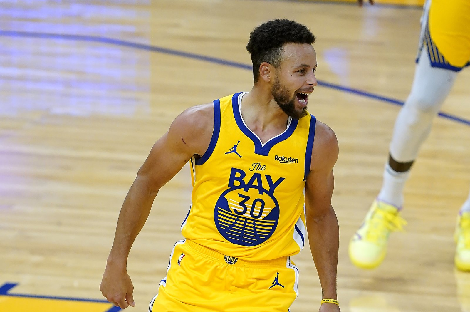 Golden State Warriors' Stephen Curry reacts after scoring during an NBA game against the Portland Trail Blazers, in San Francisco, California, U.S., Jan. 3, 2021. (AP Photo)