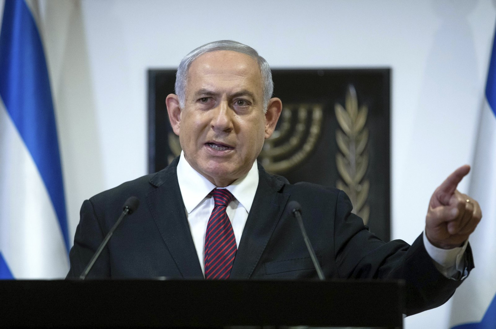 Israeli Prime Minister Benjamin Netanyahu delivers a statement at the Israeli Knesset, Jerusalem, Dec. 22, 2020. (AP Photo)