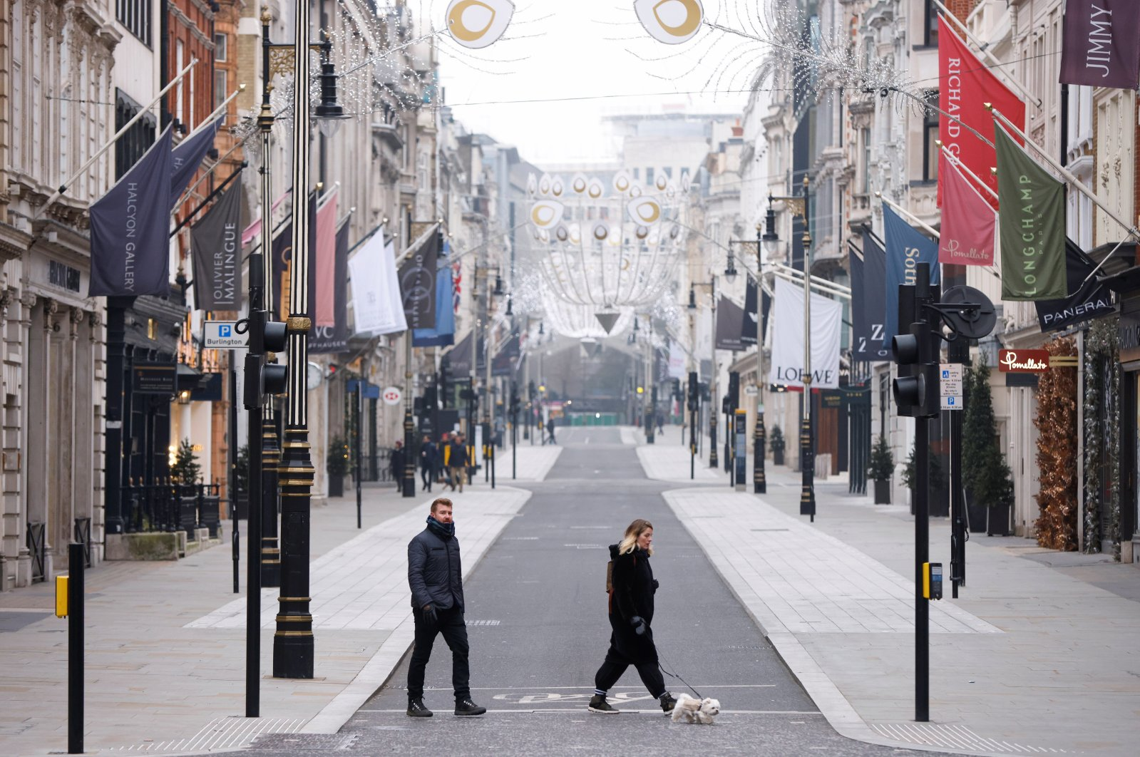 People walk their dog along New Bond Street on New Year's Day amid the coronavirus disease (COVID-19) outbreak, in London, Britain Jan. 1, 2021. (Reuters Photo)