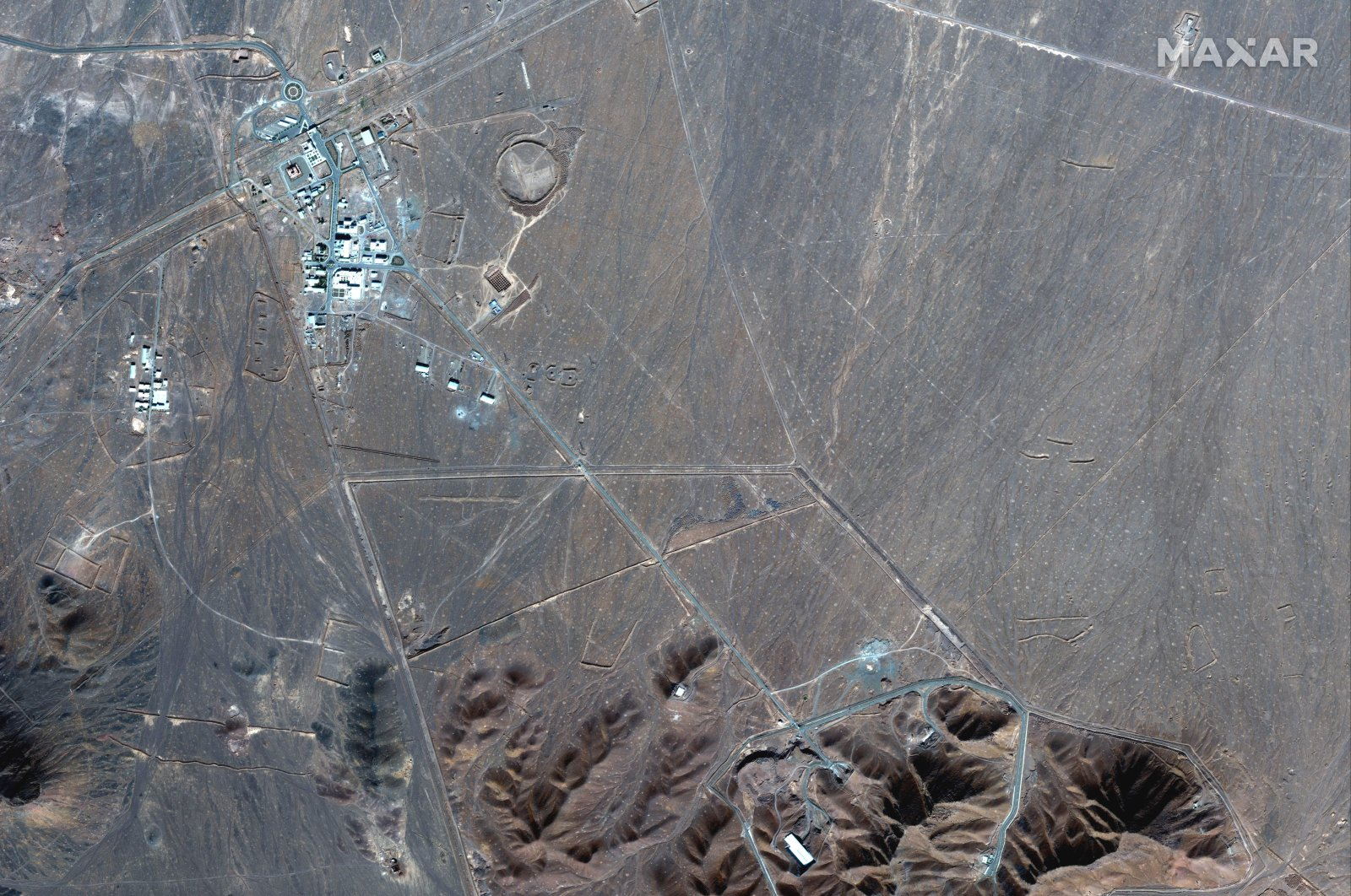 This satellite photo by Maxar Technologies shows the Fordo nuclear site in Iran, Nov. 4, 2020. (Maxar Technologies via AP)