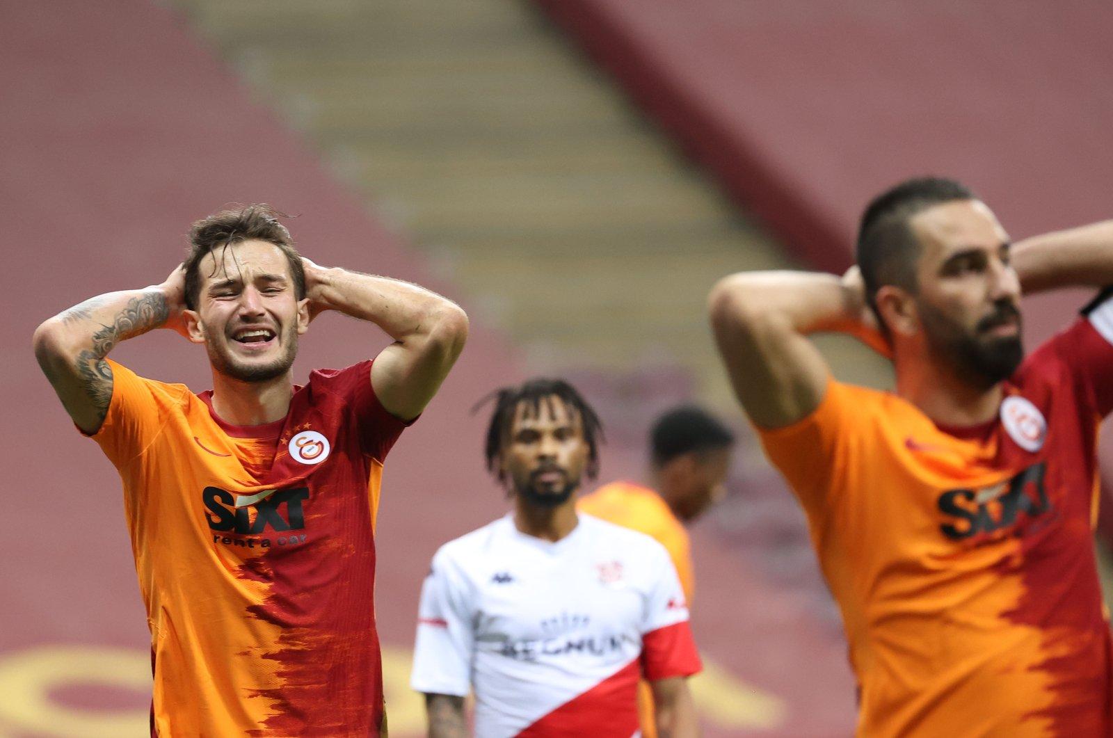 Galatasaray's Oğulcan Çağlayan (L) and Arda Turan (R) react during a Süper Lig match against Antalyaspor at the Türk Telekom Arena, in Istanbul, Turkey, Jan. 2, 2021. (AA Photo)