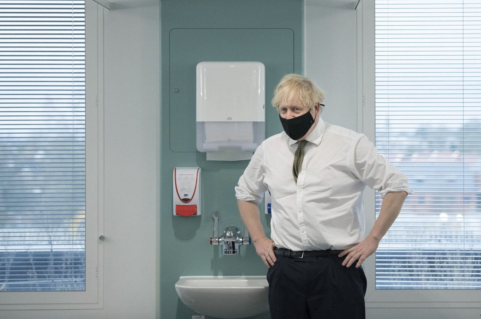 Britain's Prime Minister Boris Johnson during a visit to view the vaccination program at the Chase Farm Hospital, part of the Royal Free London NHS Foundation Trust, in north London, Jan. 4, 2021. (AP Photo)