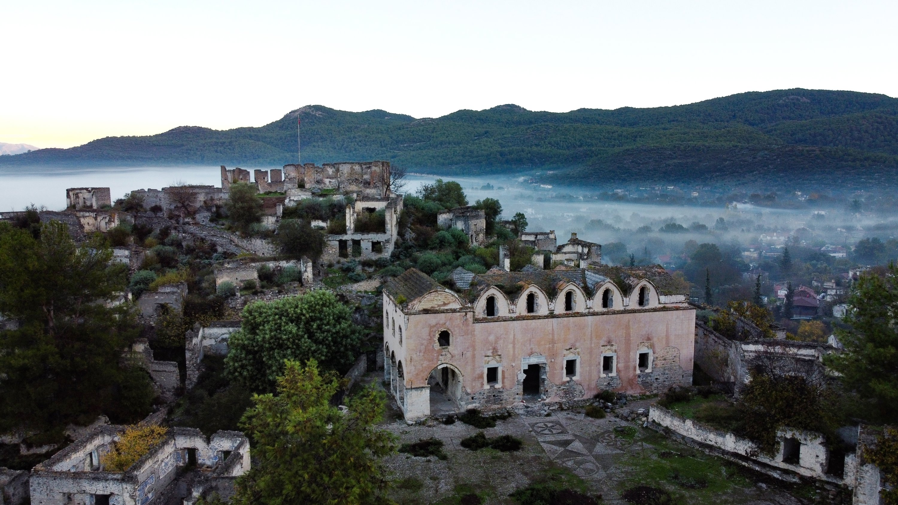 Abandoned buildings are seen through the fog in Kayaköy, Muğla province, Dec. 11, 2020. (AA Photo)