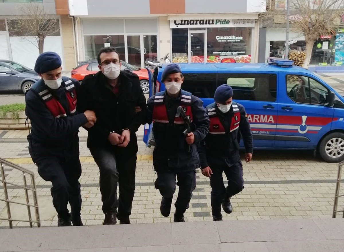 Gendarmerie officers escort a FETÖ suspect captured in the Çan district, in Çanakkale, western Turkey, Jan. 5, 2021. (AA PHOTO)