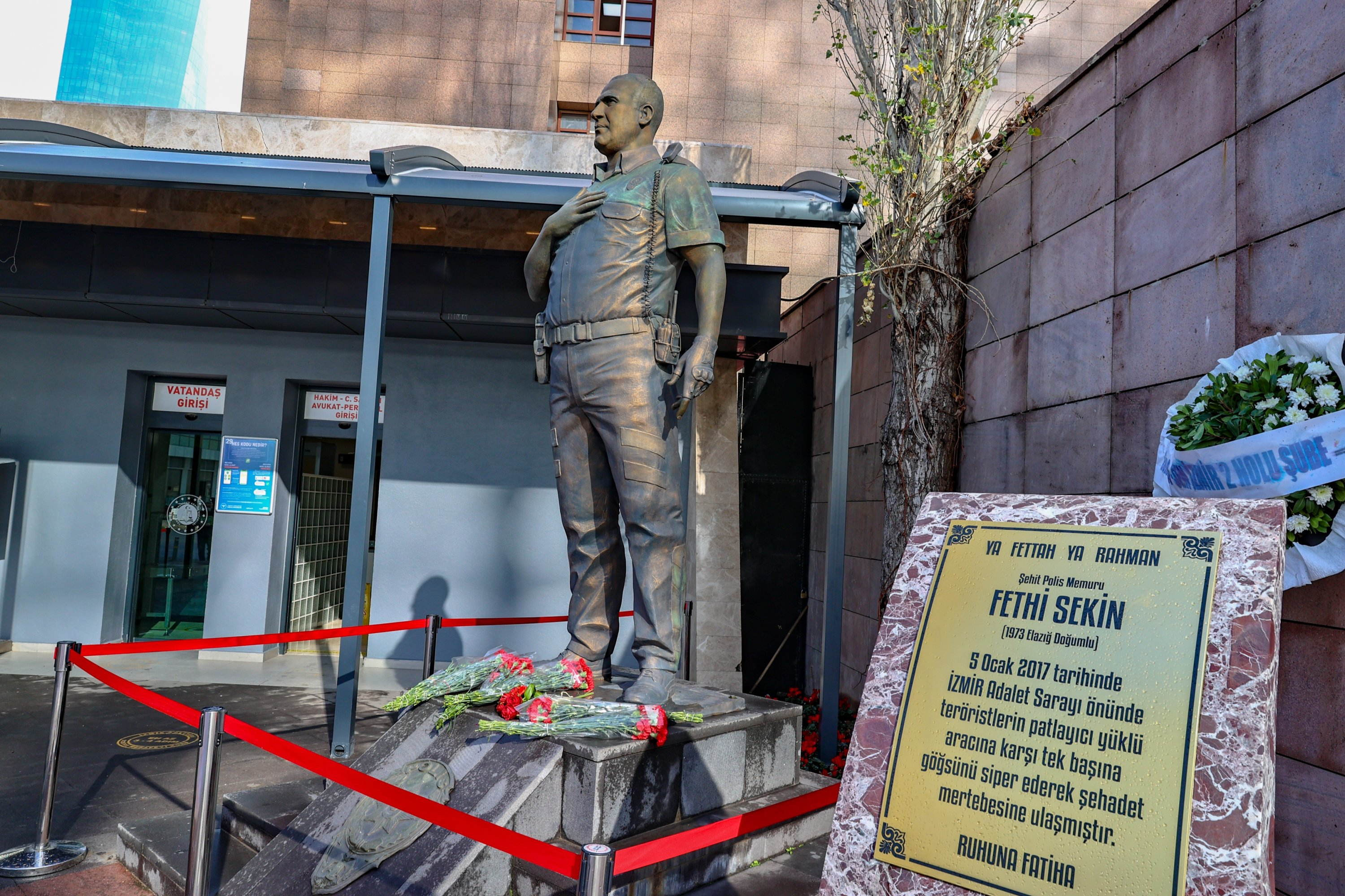 Flowers are put on the statue of Police Officer Fethi Sekin in memory of the fourth anniversary of his killing by PKK terrorists, in Izmir, Turkey, Jan. 5, 2021.