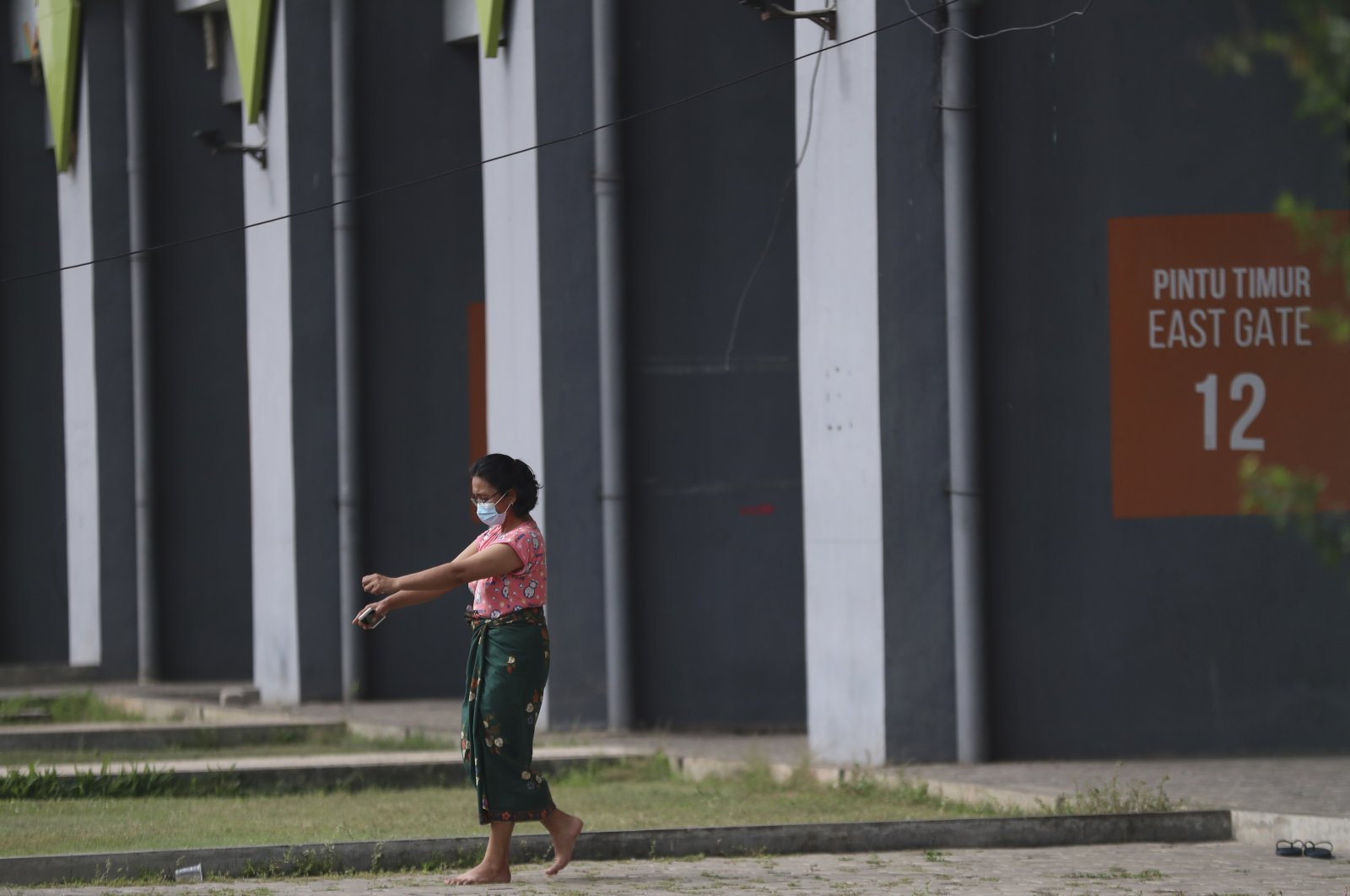 A COVID-19 patient exercises at Patriot Candrabhaga Stadium which is turned into isolation center for people showing symptoms amid the coronavirus outbreak in Bekasi on the outskirts of Jakarta, Indonesia, Jan. 5, 2021. (AP Photo)