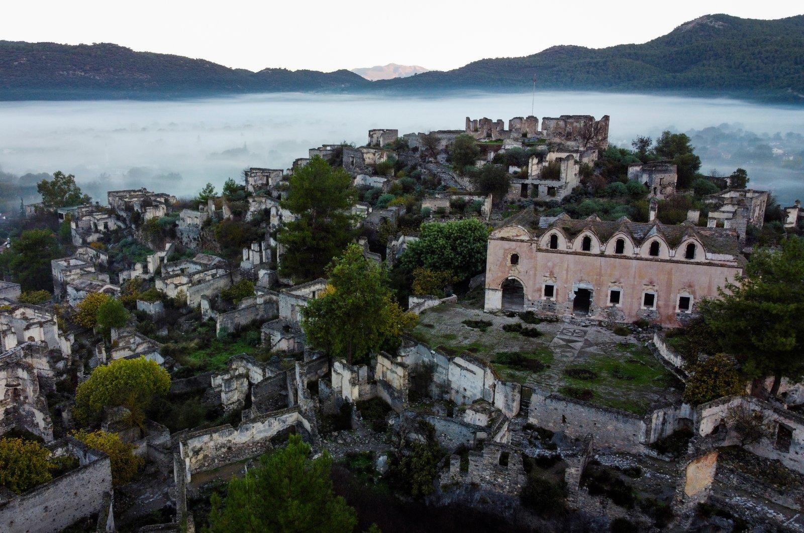 Abandoned buildings are seen through the fog in Kayaköy, Muğla province, Dec. 11, 2020. (AA Photo)