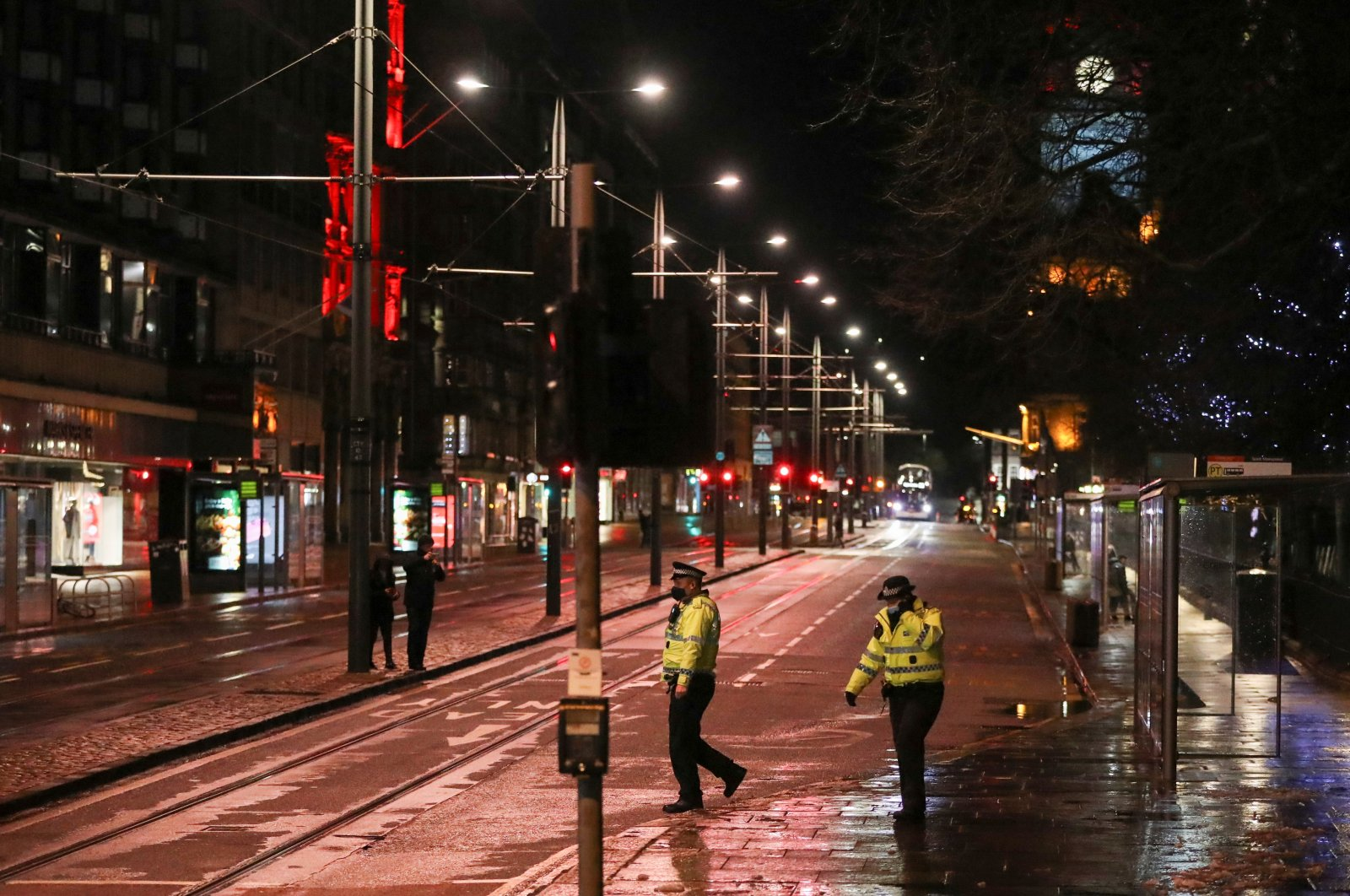 Police officers cross a nearly empty street during New Year's Eve amid the coronavirus pandemic, in Edinburgh, Britain, Dec. 31, 2020. (Reuters Photo)