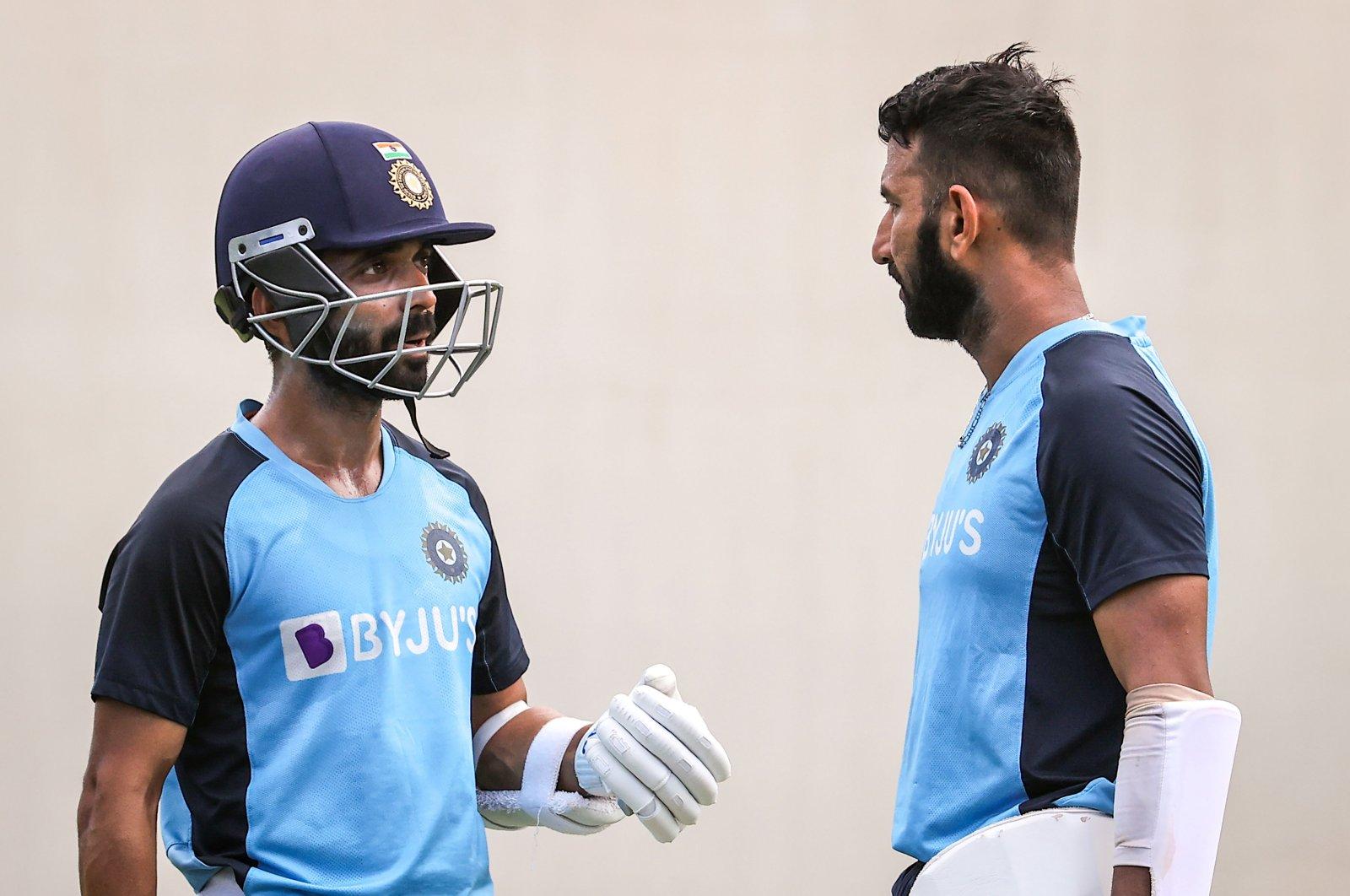 India's Cheteshwar Pujara (R) talks to the team's captain Ajinkya Rahane during a training session, in Sydney, Australia, Jan. 5, 2021. (AFP Photo)